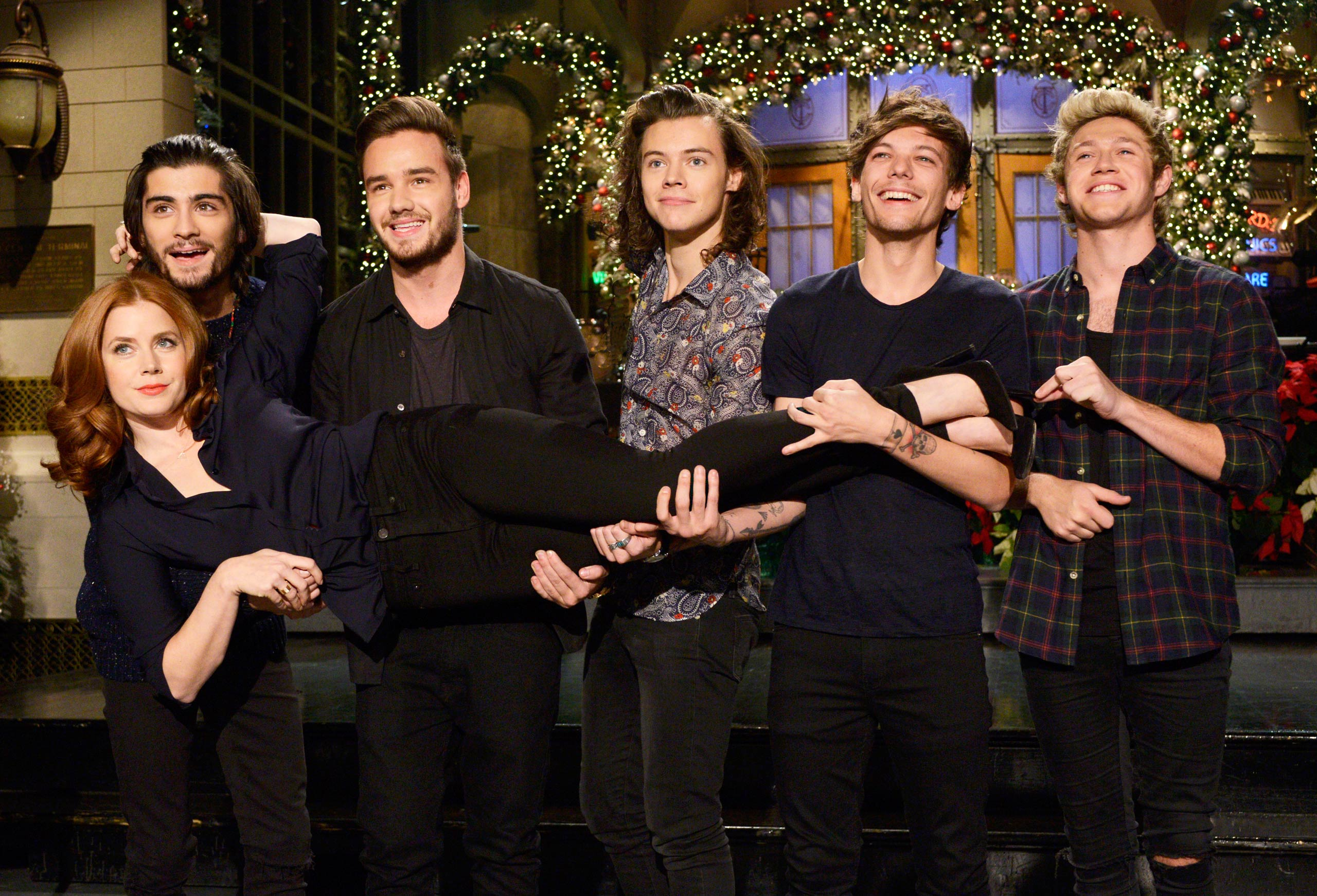Amy Adams and One Direction members Zayn Malik, Liam Payne, Harry Styles, Louis Tomlinson and Niall Horan appear on <i>Saturday Night Live</i> on Dec. 18, 2014.