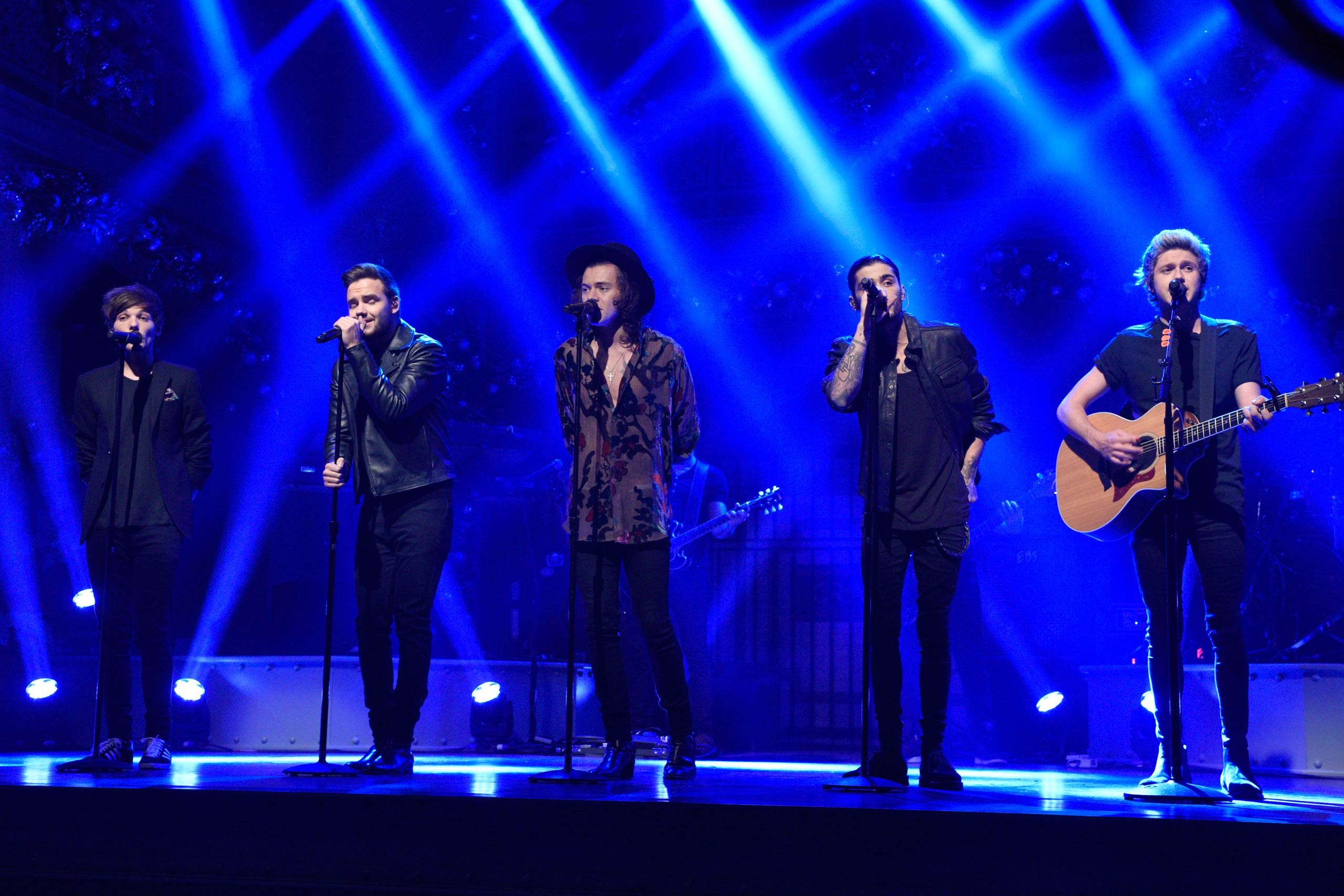 Louis Tomlinson, Liam Payne, Harry Styles, Zayn Malik and Niall Horan of One Direction perform on <i>Saturday Night Live</i> on Dec. 18, 2014.
