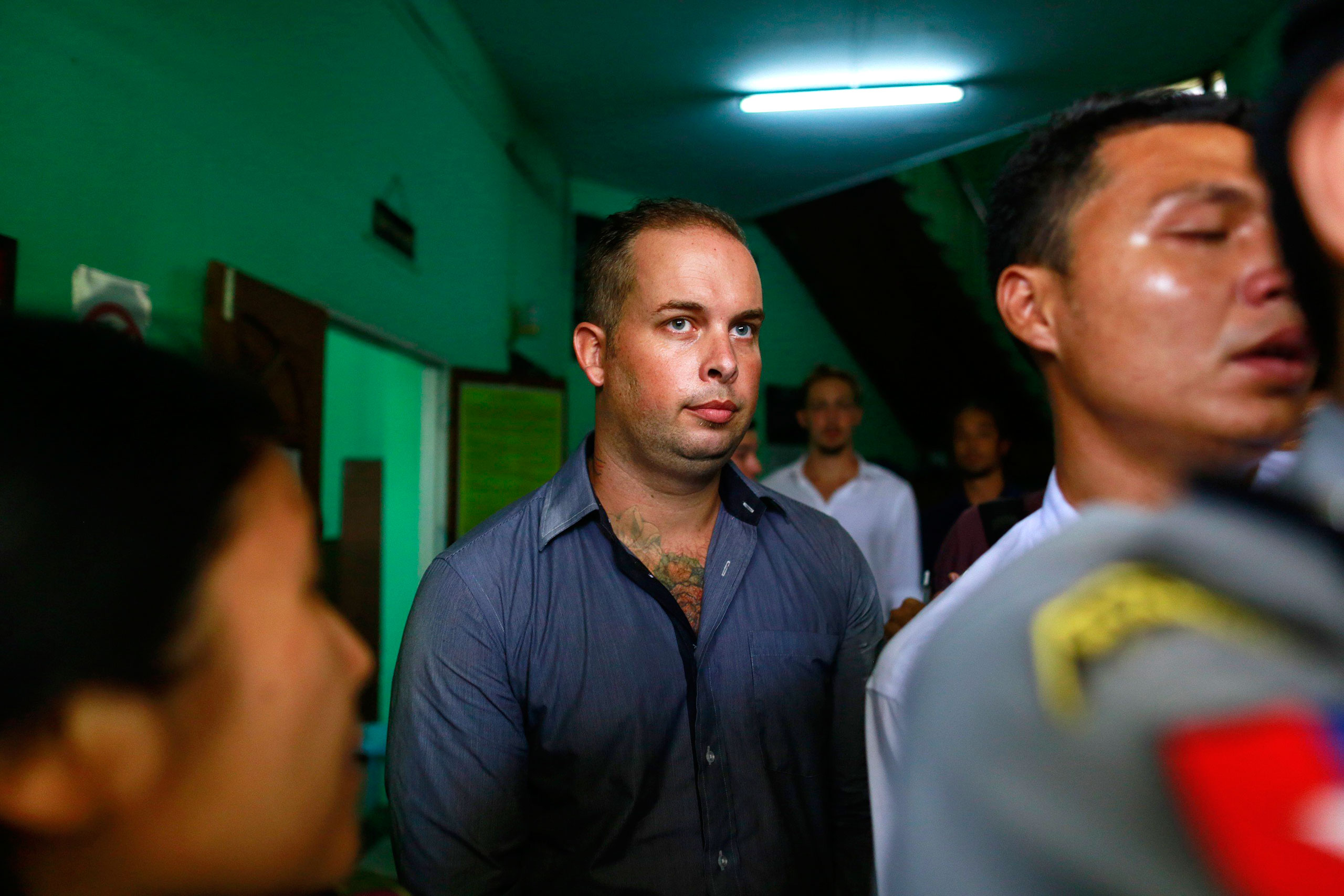 Phil Blackwood, a bar manager from New Zealand, comes out of court after being sentenced to two and half years in prison, at Bahan township court in Yangon on March 17, 2015.