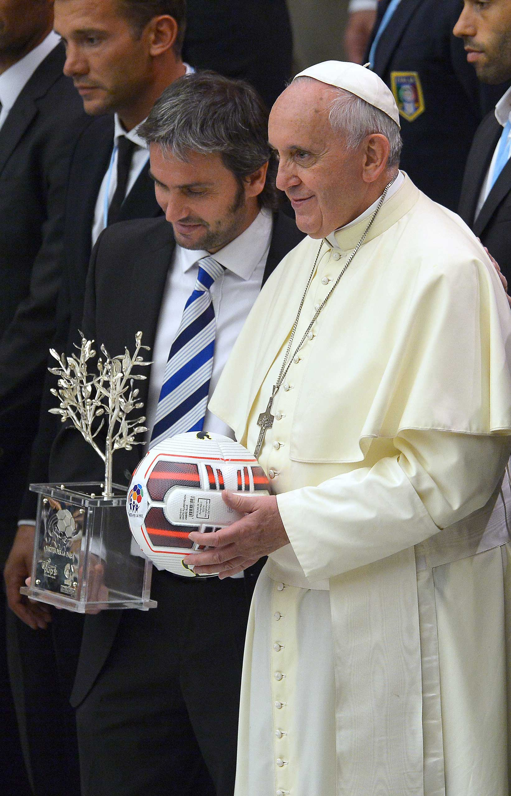 Argentinian silversmith Adrián Pallaros and Pope Francis pose with international soccer players at the Vatican on Sept. 2014 prior to an inter-religious  match for peace  soccer game that was played at Rome's Olympic Stadium.