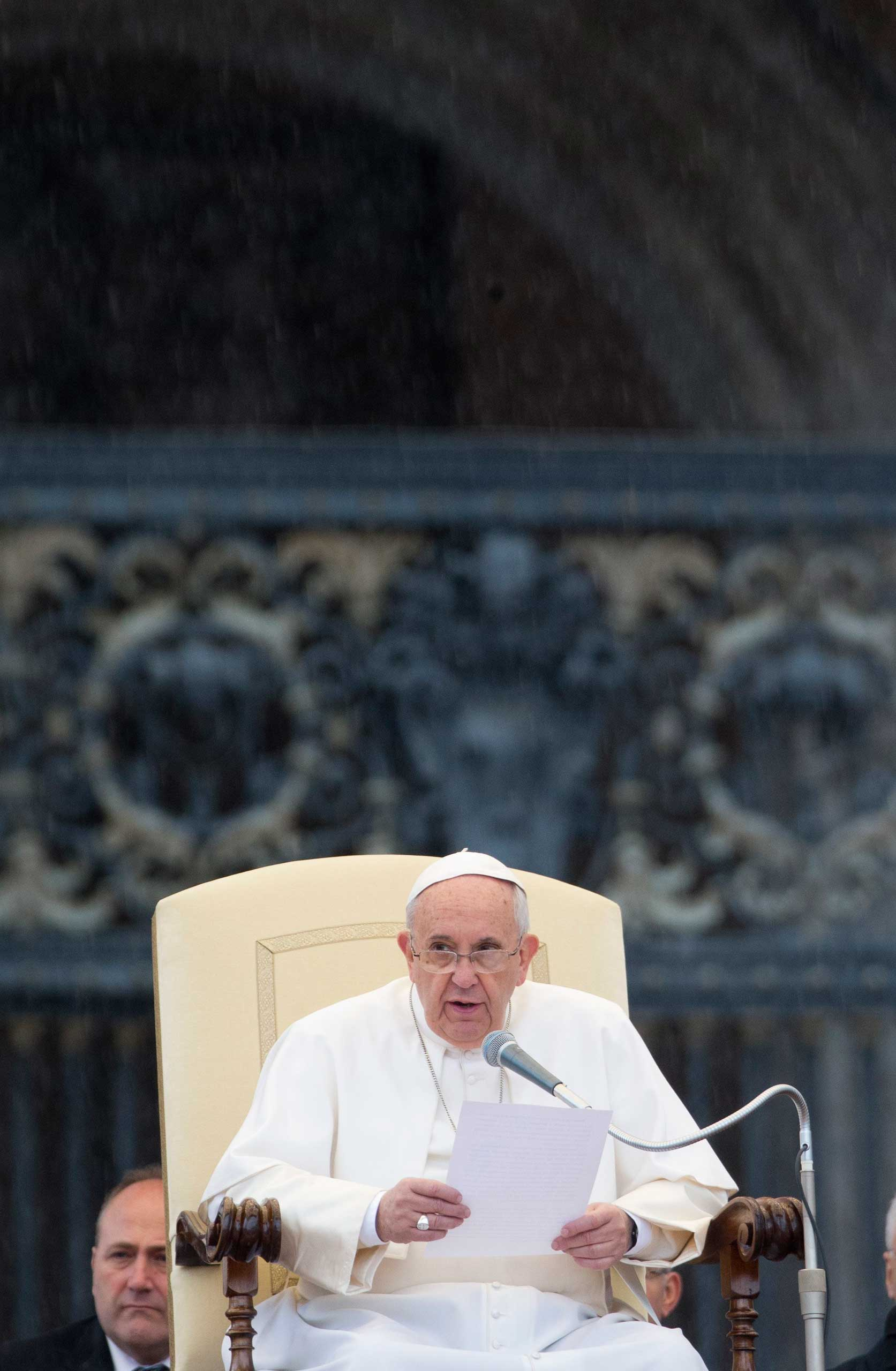 Pope Francis speaks during his weekly general audience in St. Peter's Square at the Vatican, March 25, 2015.