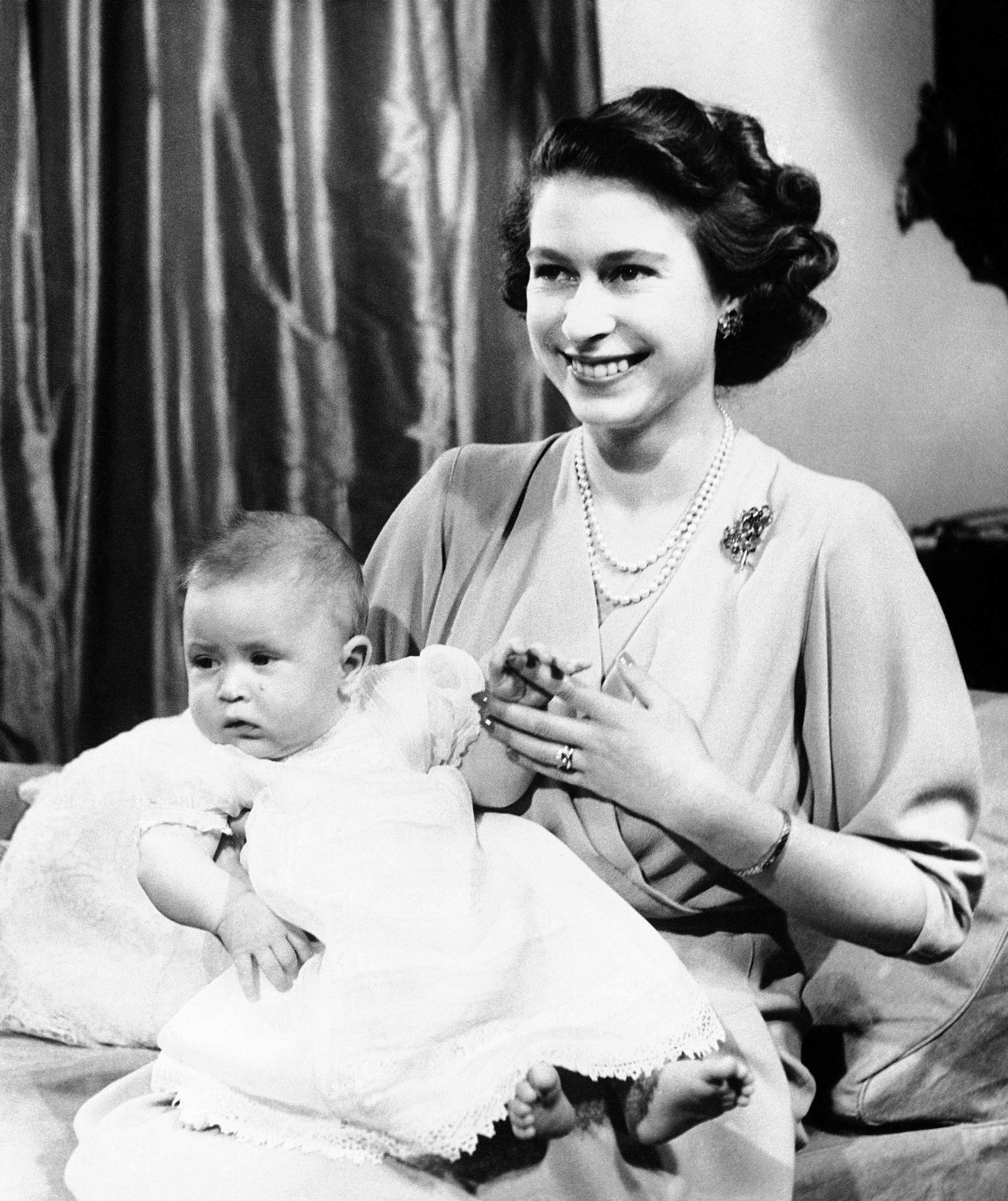 Before Princes Charles was born in 1948, his grandfather King George VI did away with a long-held custom that demanded the Home Secretary be present at royal births. Here Charles is pictured with his mother, at that stage still Princess Elizabeth.