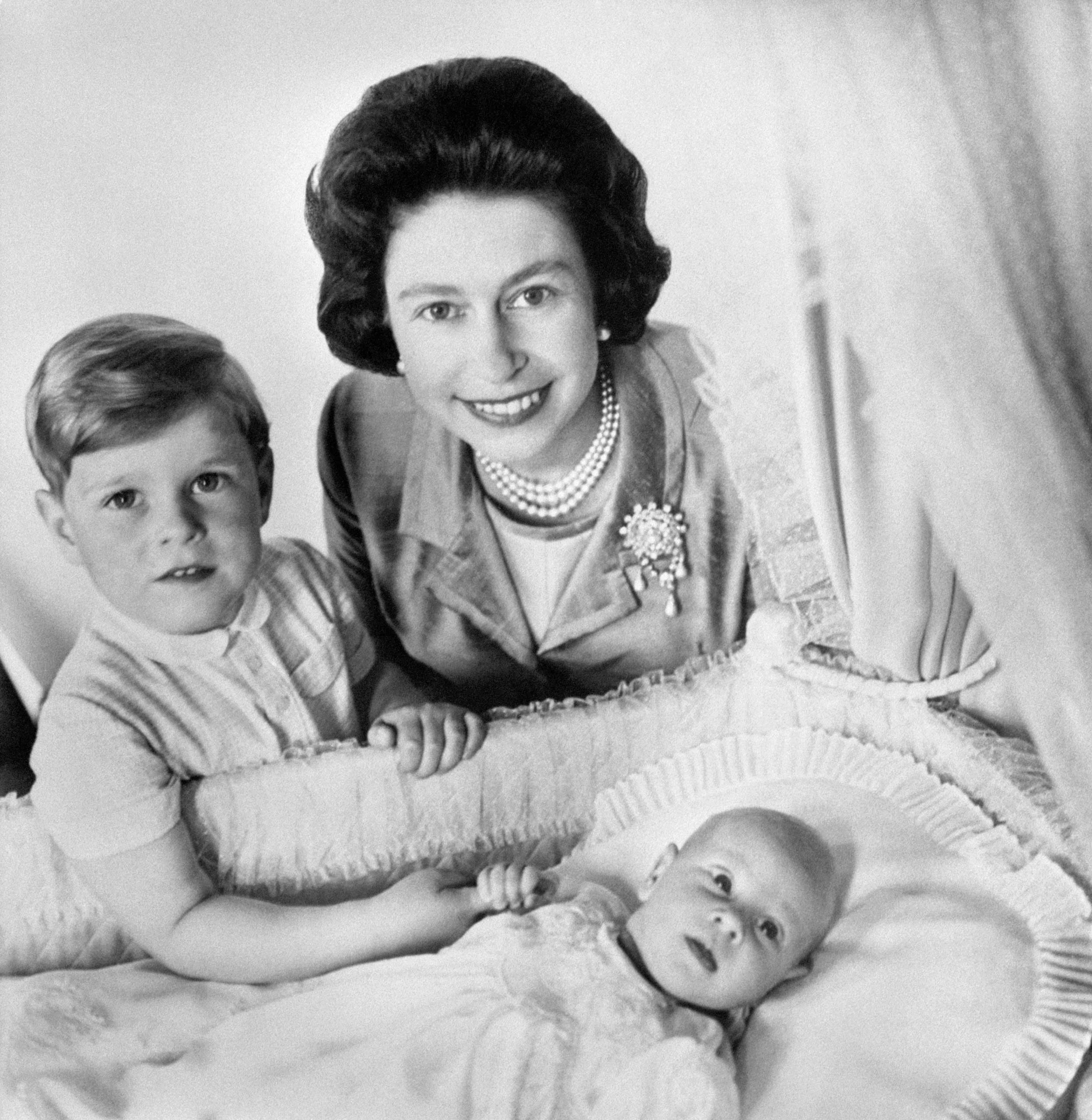 This 1964 snap of Prince Edward in his cot, with brother Andrew and his mother, the Queen, already suggests an interest in what's going on behind the camera. He went on to found a TV production company in 1993.