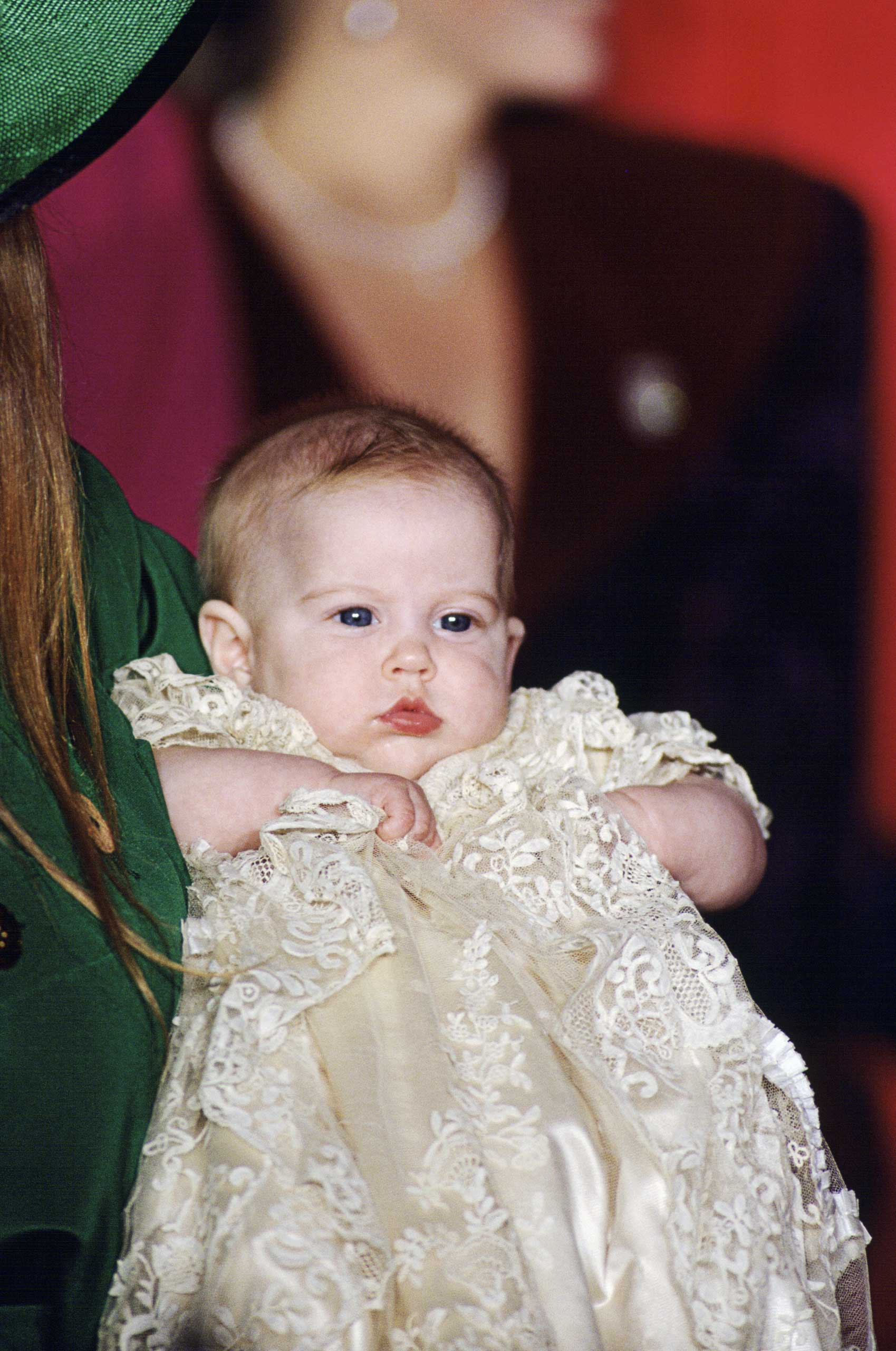 The spitting image of her dad Prince Andrew, but for the red hair inherited from mother Sarah, Duchess of York, Princess Beatrice looks pensive at her 1988 christening.