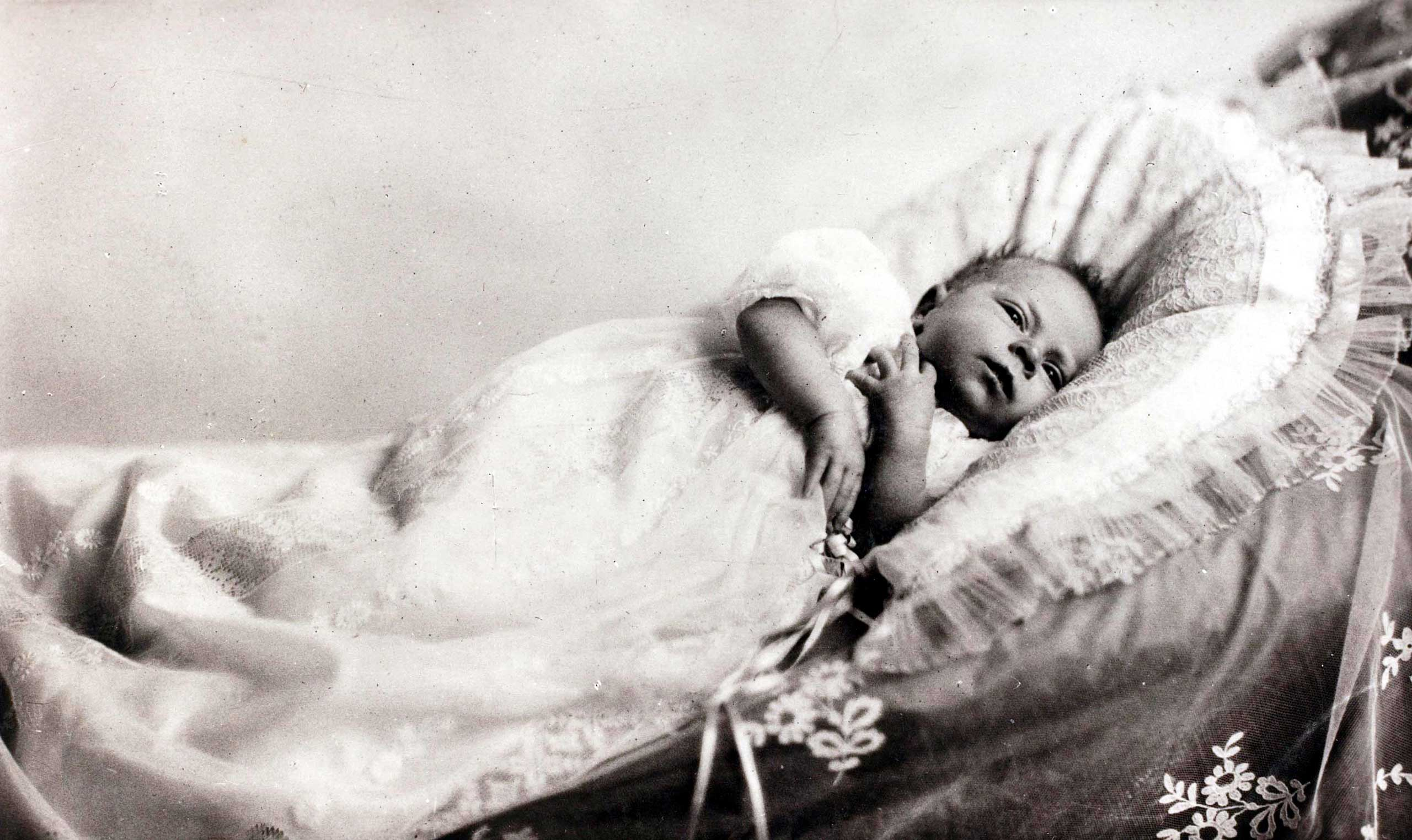 In 1926, as a tiny baby, Princess Elizabeth already displays the solemn face that she has deployed so often in her public duties since becoming Queen.