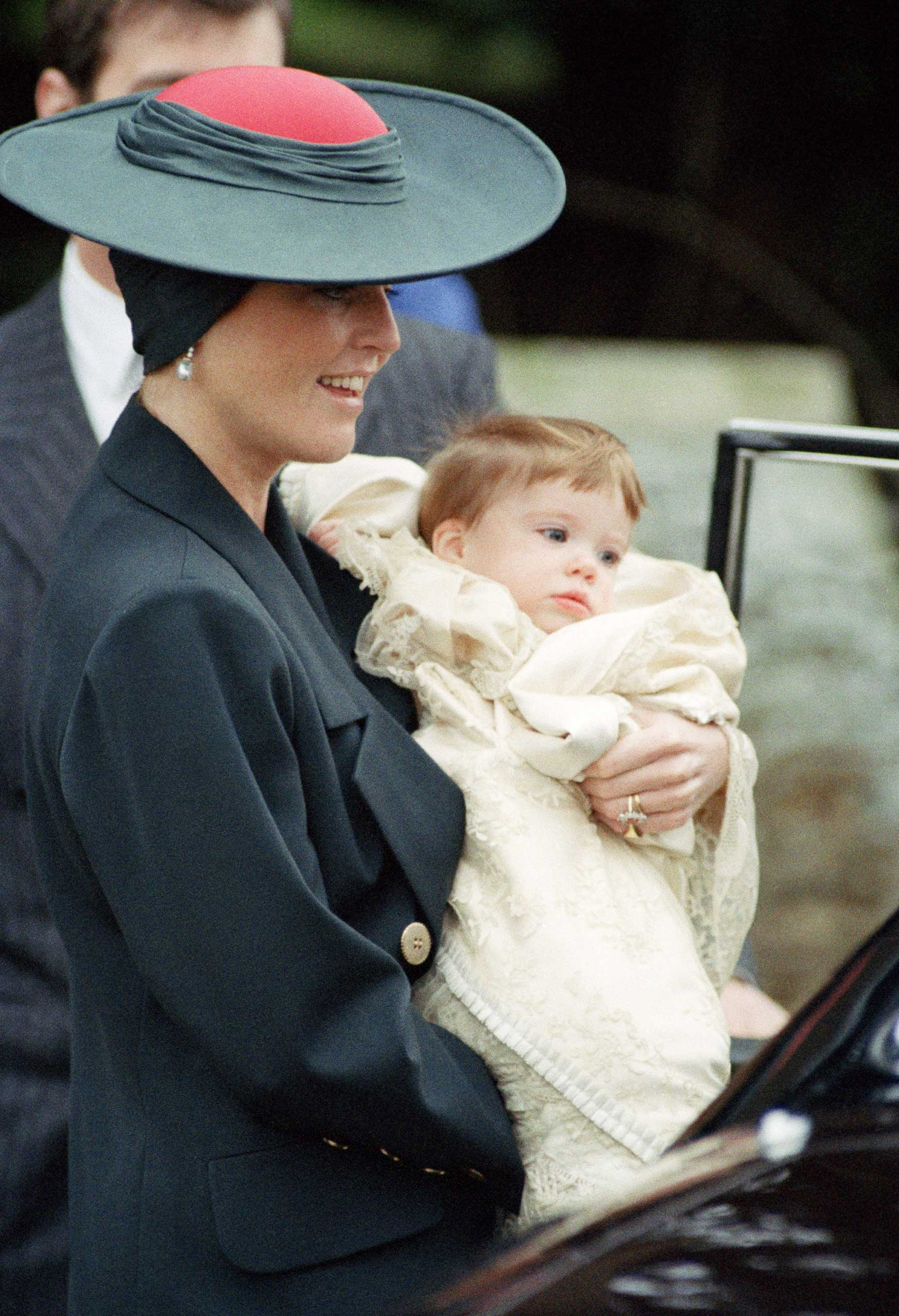 Another addition to the house of York: Princess Eugenie, with her mother Sarah, at her christening in 1990.