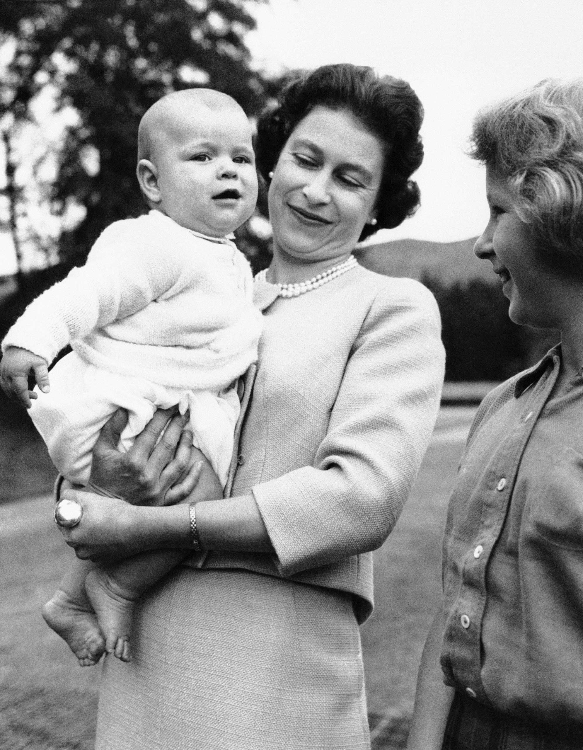 She already had an heir. Here's Queen Elizabeth with the spare: a chubby, 6-month-old Prince Andrew, in the grounds of Balmoral Castle, Scotland in 1960.