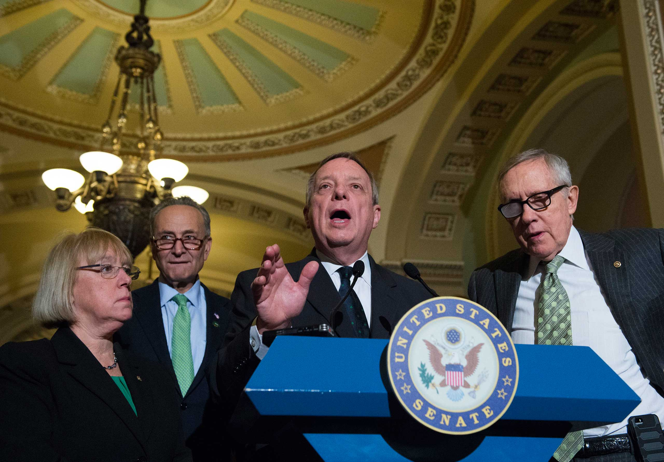 Senate Minority Whip Richard Durbin, D-Ill., speaks to reporters on Capitol Hill in Washington on March 17, 2015. From left are, Sen. Patty Murray, D-Wash., Sen. Charles Schumer, D-N.Y. Durbin, and Senate Minority Leader Harry Reid of Nev.