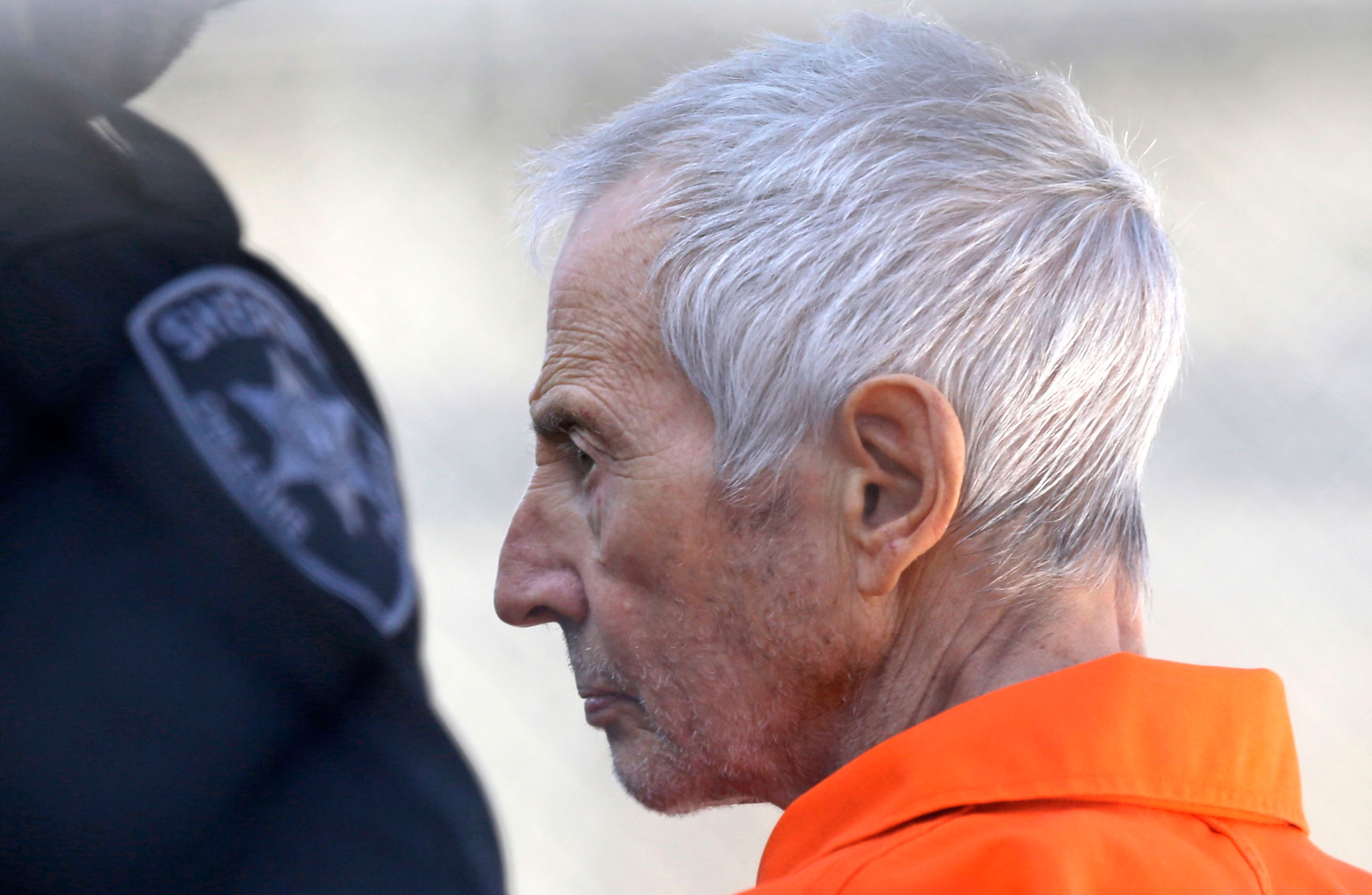 Robert Durst is escorted into Orleans Parish Prison after his arraignment in Orleans Parish Criminal District Court in New Orleans, March 17, 2015.