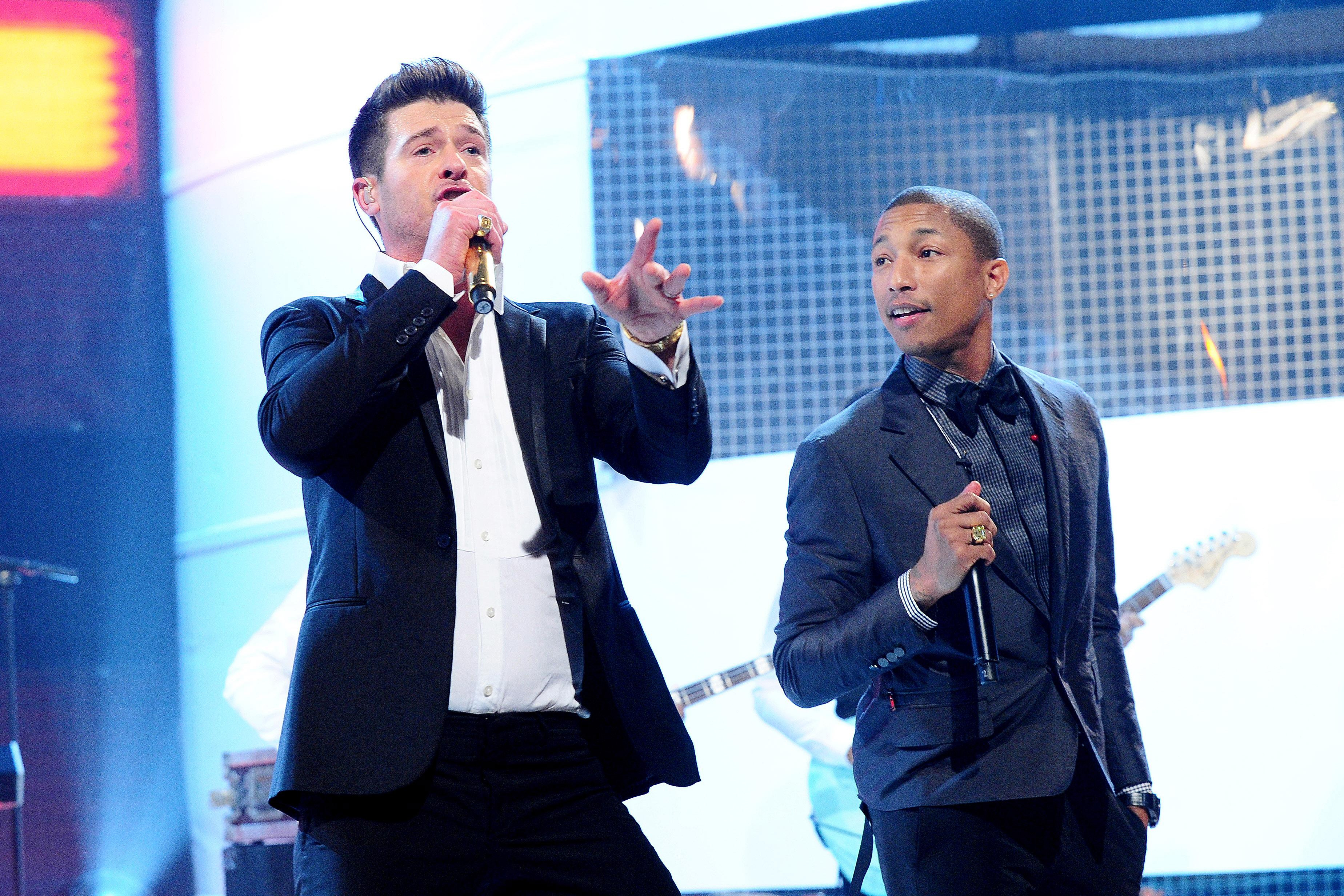 Robin Thicke and Pharrell performing in 2013.