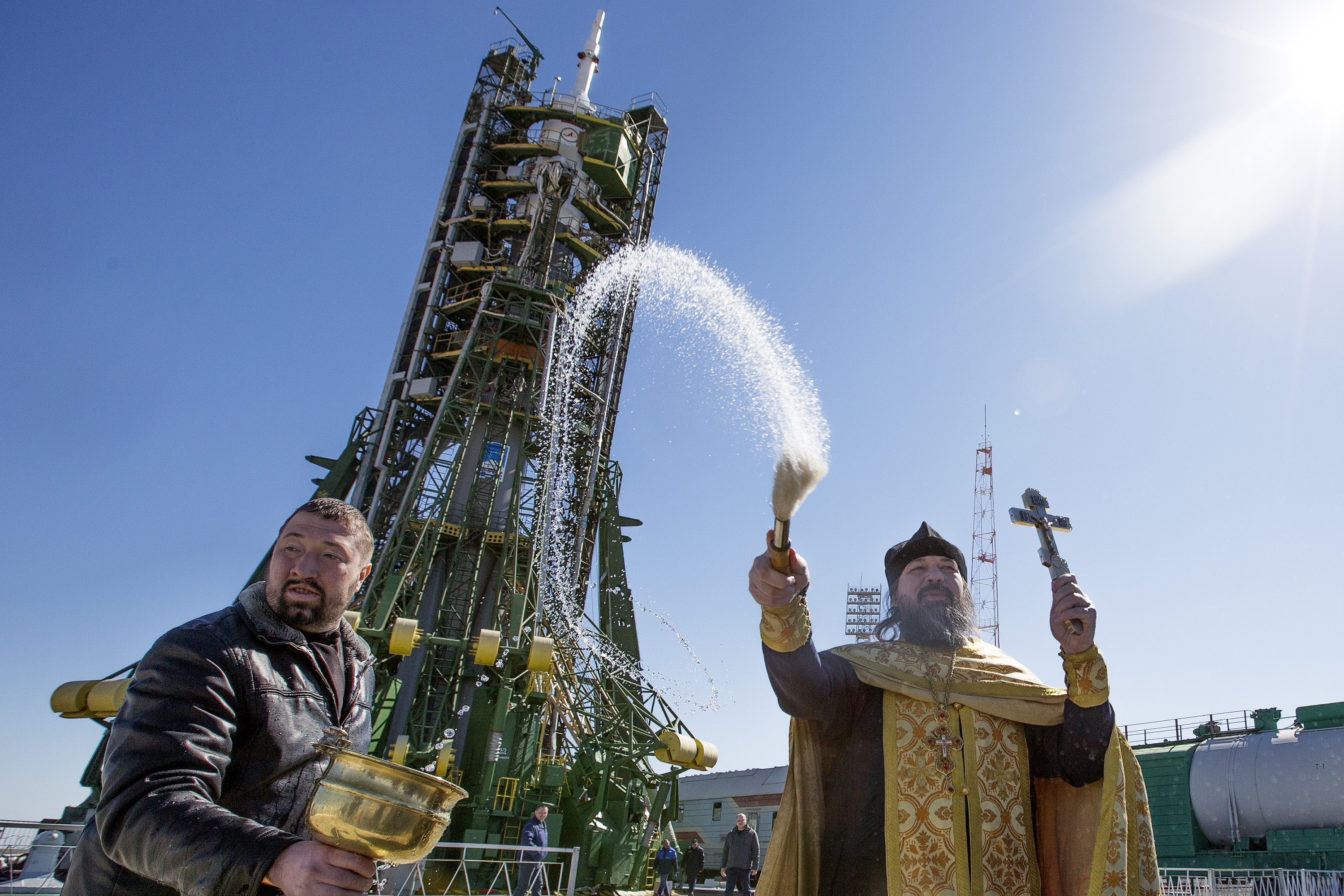 A Russian orthodox priest blesses the Soyuz Rocket, staff and members of the media two days before its launch.  The Rocket will carry American Astronaut Scott Kelly and Russian Cosmonauts Mikhail Kornienko and Gennady Padalka to the International Space Station.