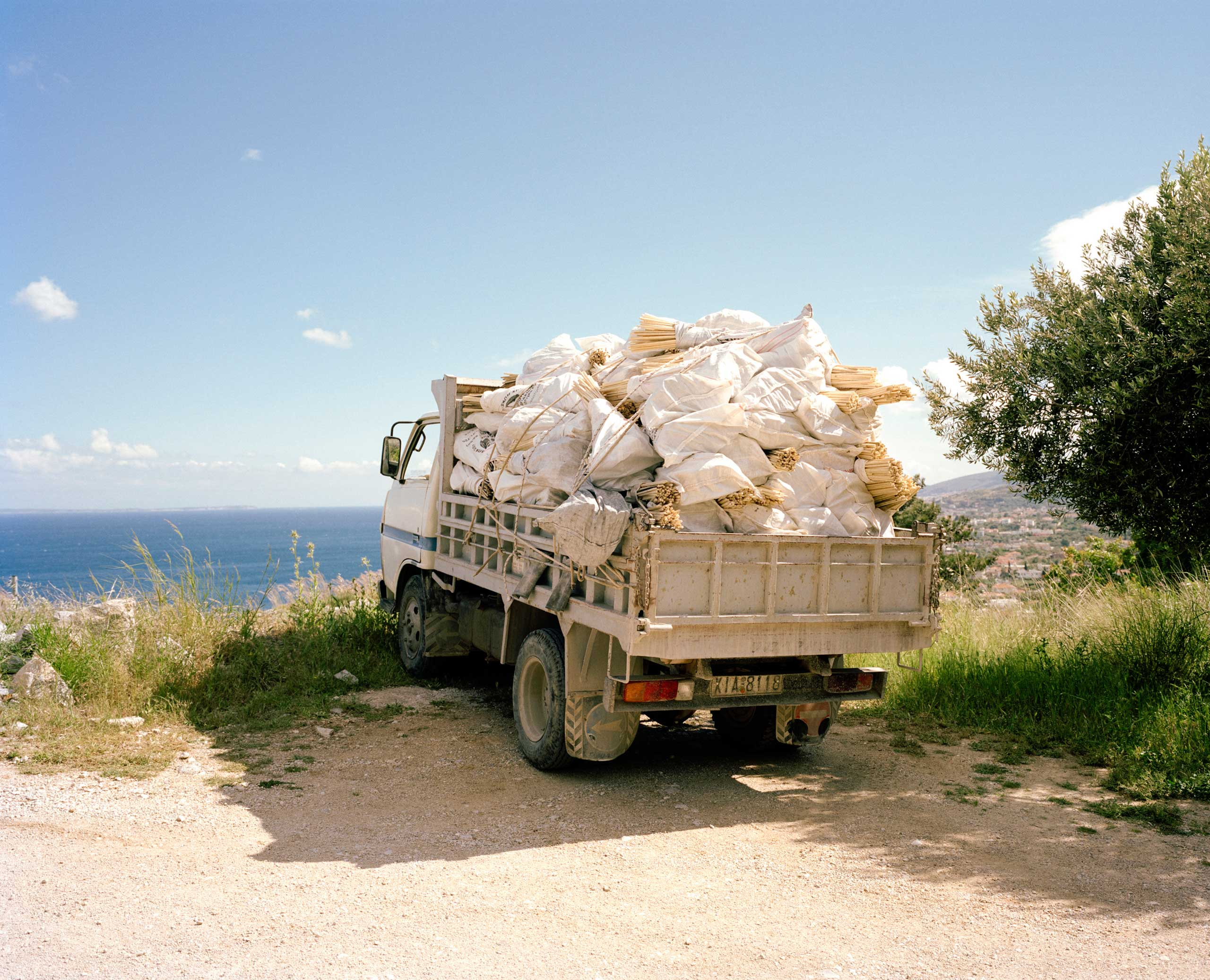 A truck waits to transport 8,000 homemade rockets down to the village after being stored in hiding for the past few months in Vrontados, Chios, Greece.