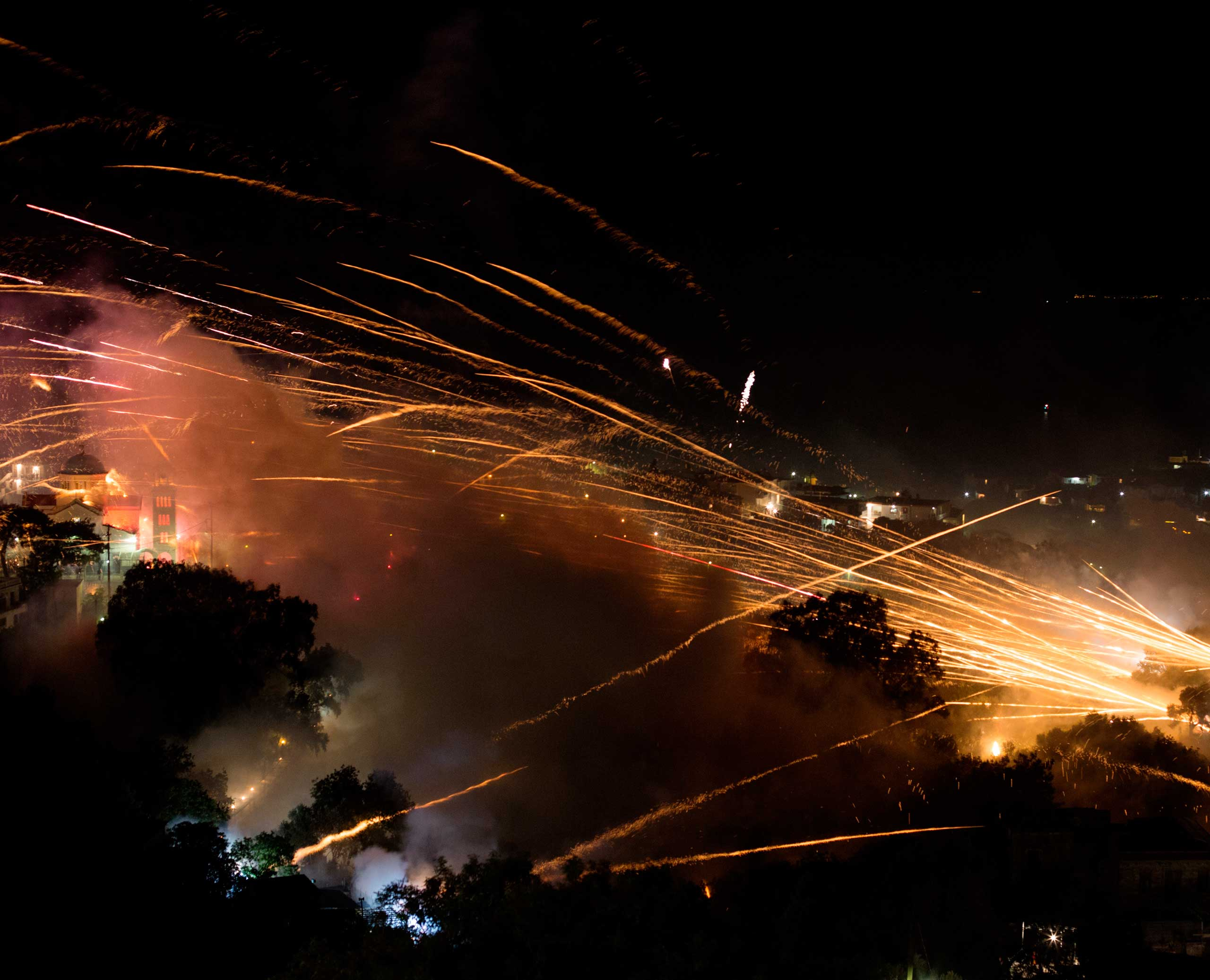 Rockets rain down on the village of in Vrontados, Chios, Greece.
