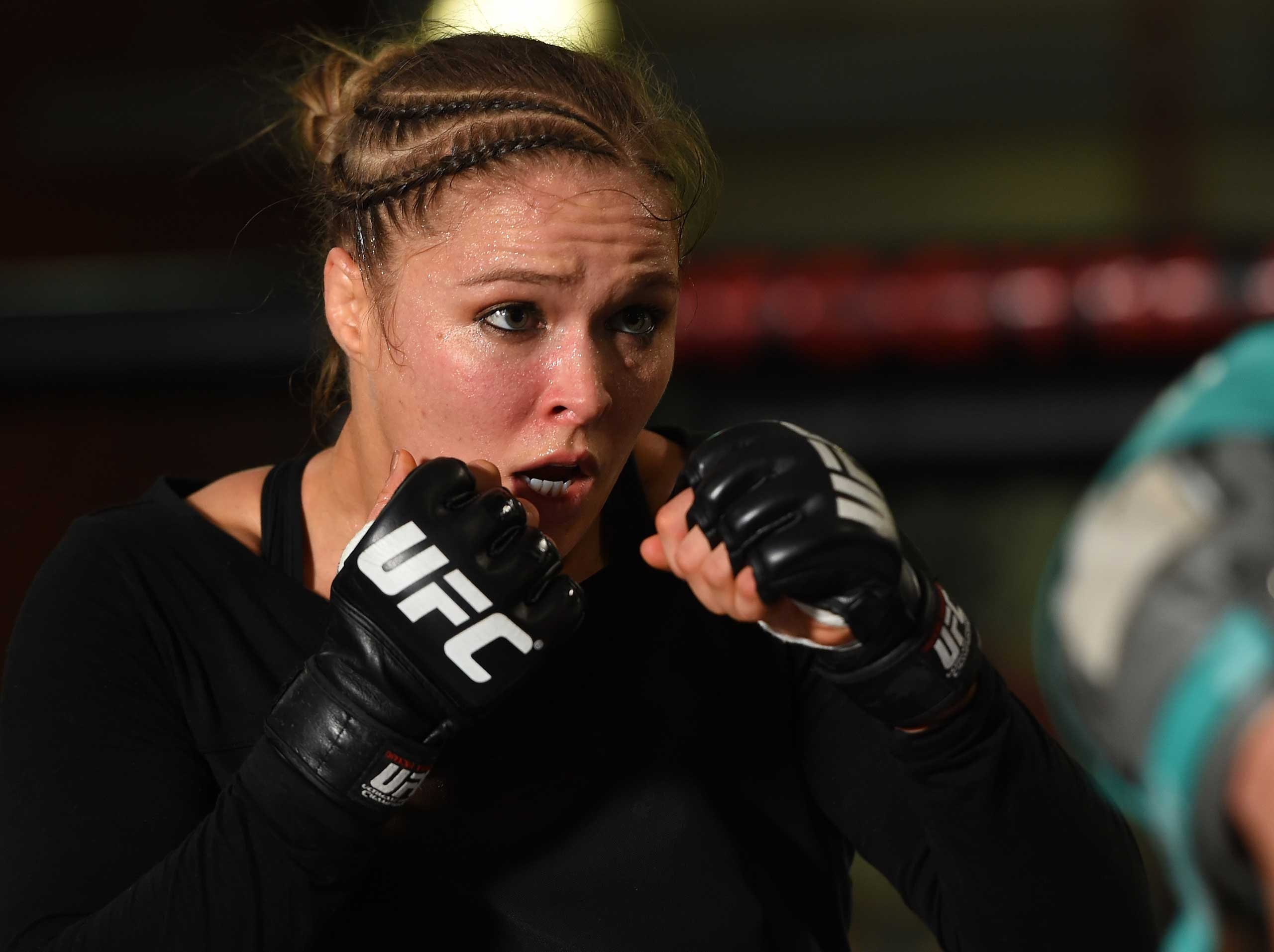 UFC women's bantamweight champion Ronda Rousey holds an open training session for fans and media at the UFC Gym in Torrance, Calif. on Feb. 24, 2015.