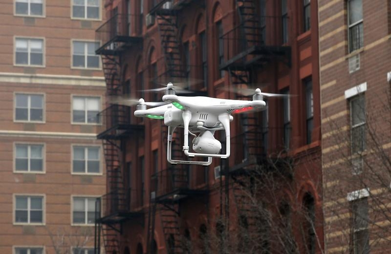 A camera drone flies in New York City, March 12, 2014