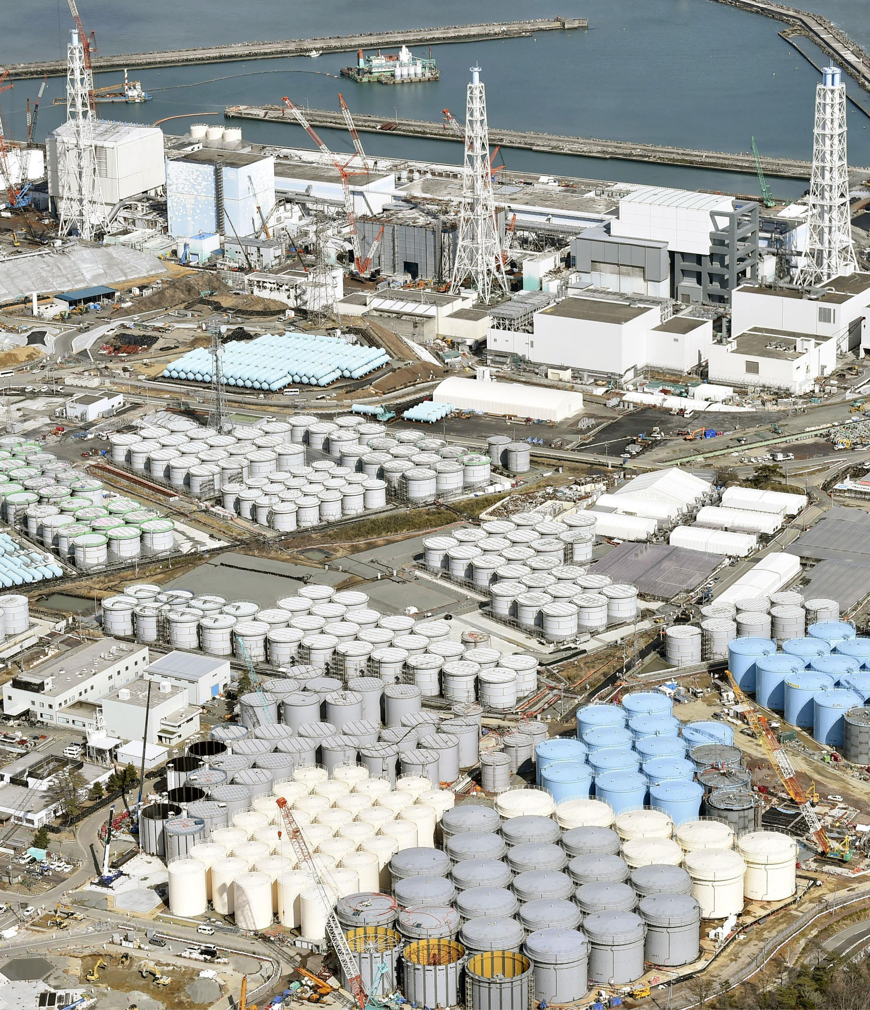 Tanks of radiation-contaminated water are seen at Tokyo Electric Power Co. (TEPCO)'s Fukushima Daiichi nuclear power plant in Fukushima, Japan on March 11, 2015.