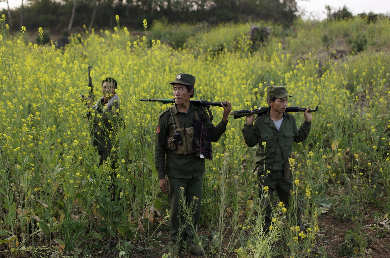 Rebel soldiers of Myanmar National Democratic Alliance Army patrol near a military base in Kokang region, in Burma, on March 10, 2015
