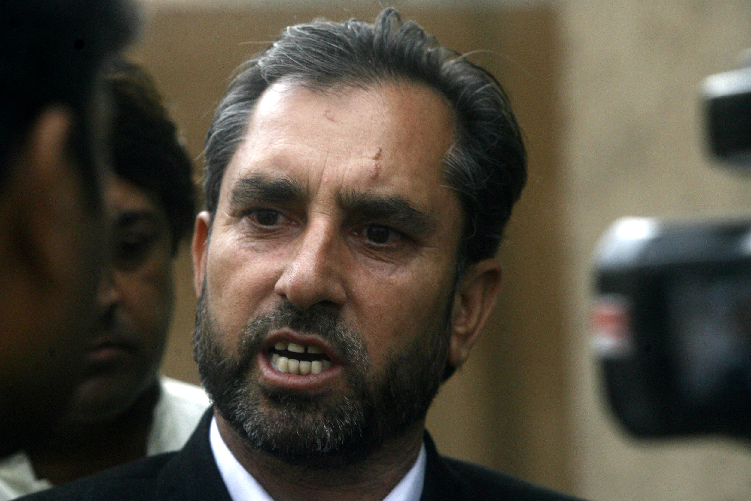 Samiullah Afridi, lawyer for Dr. Shakil Afridi who ran a fake vaccination campaign to help U.S. officials find al-Qaeda leader Osama bin laden, speaks to the media after appearing before the court in Peshawar, Pakistan, on Oct. 30, 2013