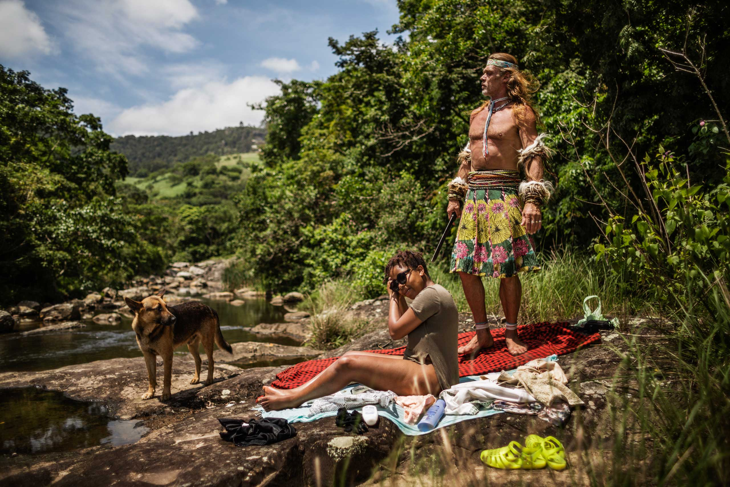 A day before her 'ingenisa', the ceremony that initiates her as a thwasa, Gugulethu Khumalo relaxes at the river with her teacher Chris Ntombemhlophe Reid on Nov. 27, 2014 in Mdakane, Lusikisiki District, South Africa.