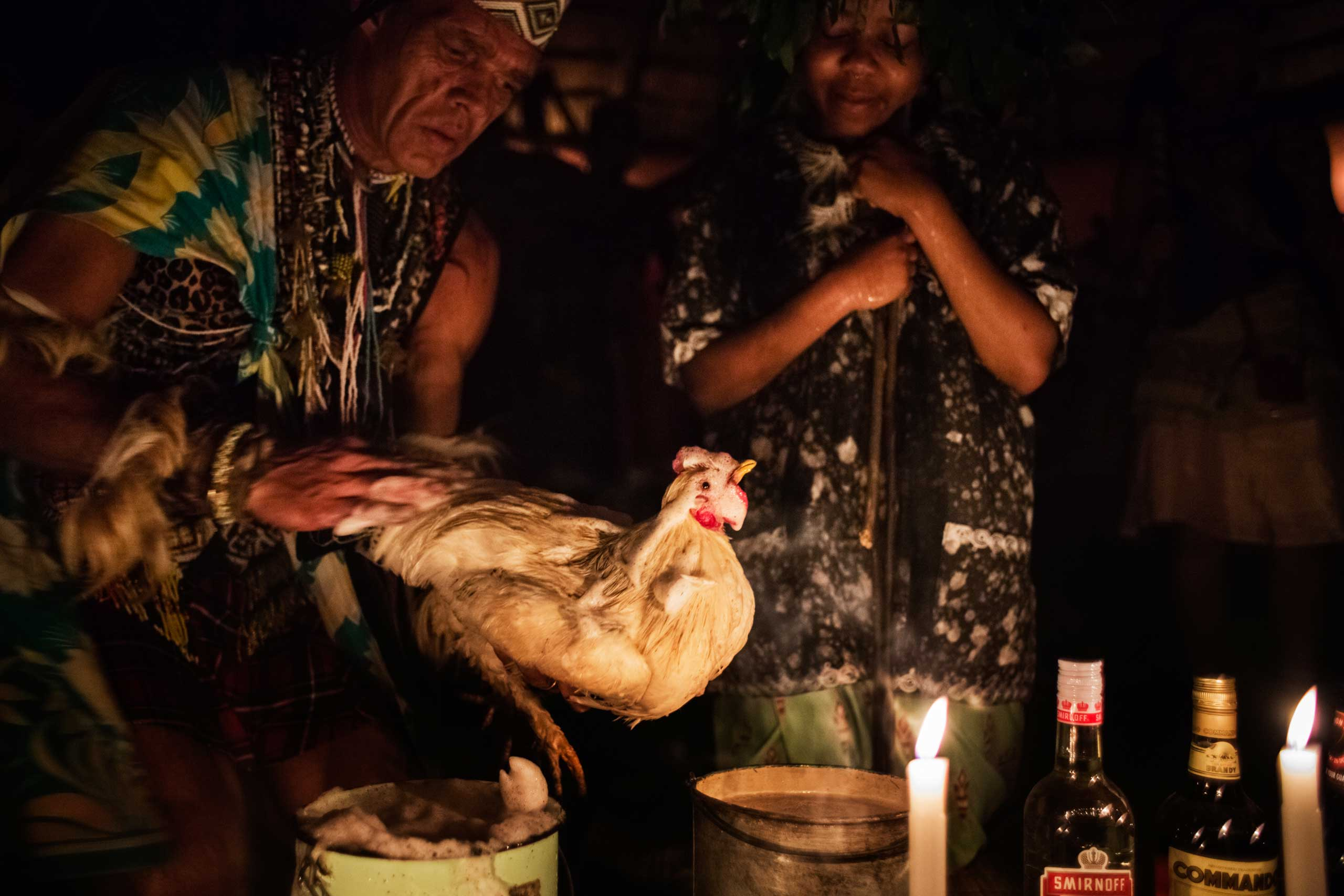 During Gugulethu Khumalo's 'ingenisa' her teacher Chris Ntombemhlophe Reid anoints a chicken with foam on Nov. 28, 2014 in Mdakane, Lusikisiki District, South Africa.