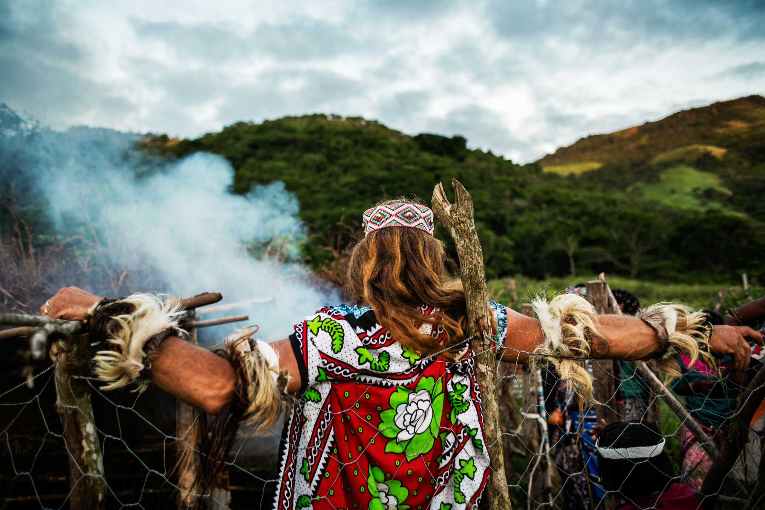 Chris Ntombemhlophe Reid stands with his fellow sangomas in a dedicated area to burn the bones of the sacrificed animals on Nov. 29, 2014 in Mdakane, Lusikisiki District, South Africa.