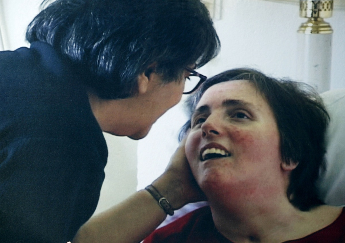 A family photo of Terri Schiavo, taken at Terri's hospital bed in 2003 in Gulfport, Fla., as seen on a protester's sign.