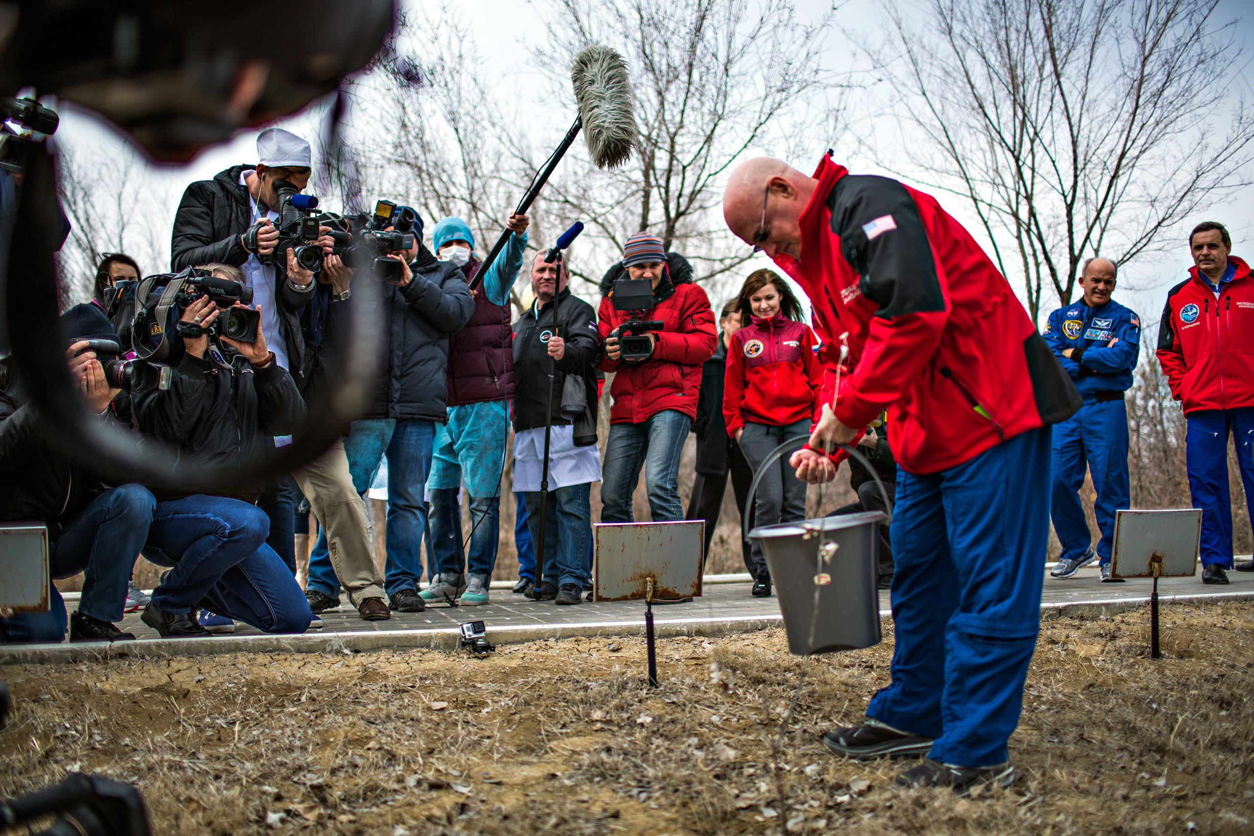 Scott Kelly waters the tree planted in his name in Baikonur, Kazhakstan on Saturday, March 21.