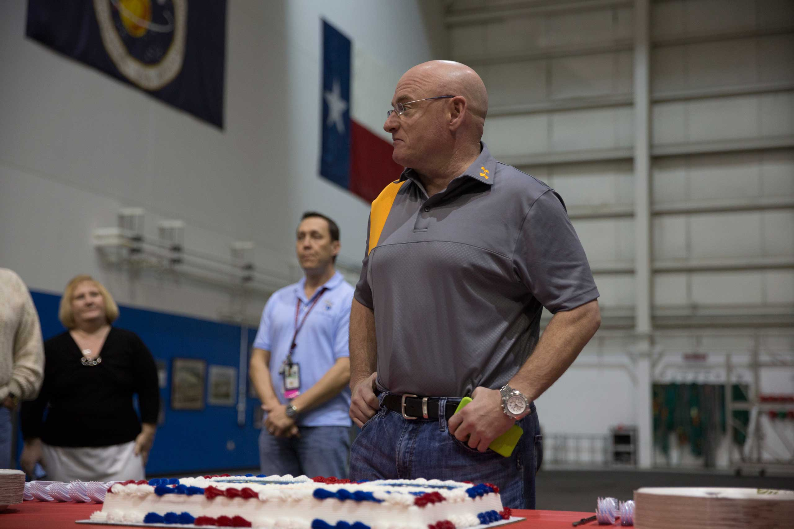 Following the successful completion of his final training in the pool, the staff at the Neutral Buoyancy Lab in Houston presented Scott with a cake wishing him well on the mission.