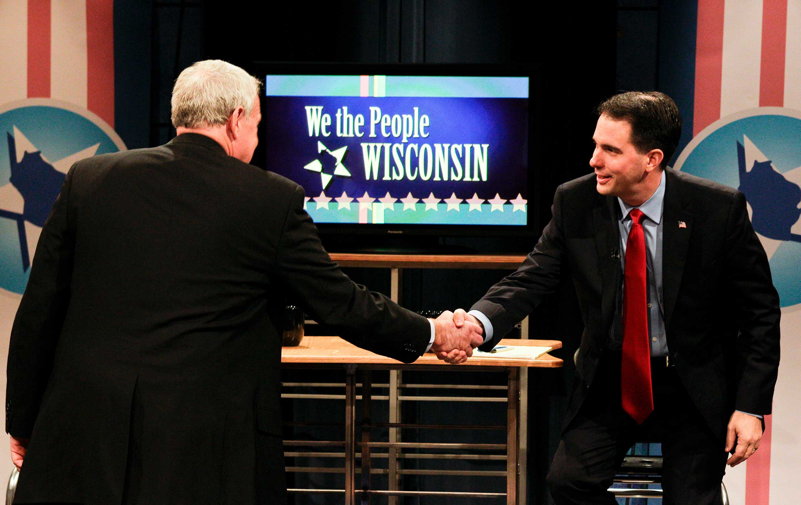 Wisconsin Governor candidates Milwaukee Mayor Tom Barrett, left, and Milwaukee County Executive Scott Walker greet each other before their final debate in Madison, Wis., on Oct. 29, 2010.