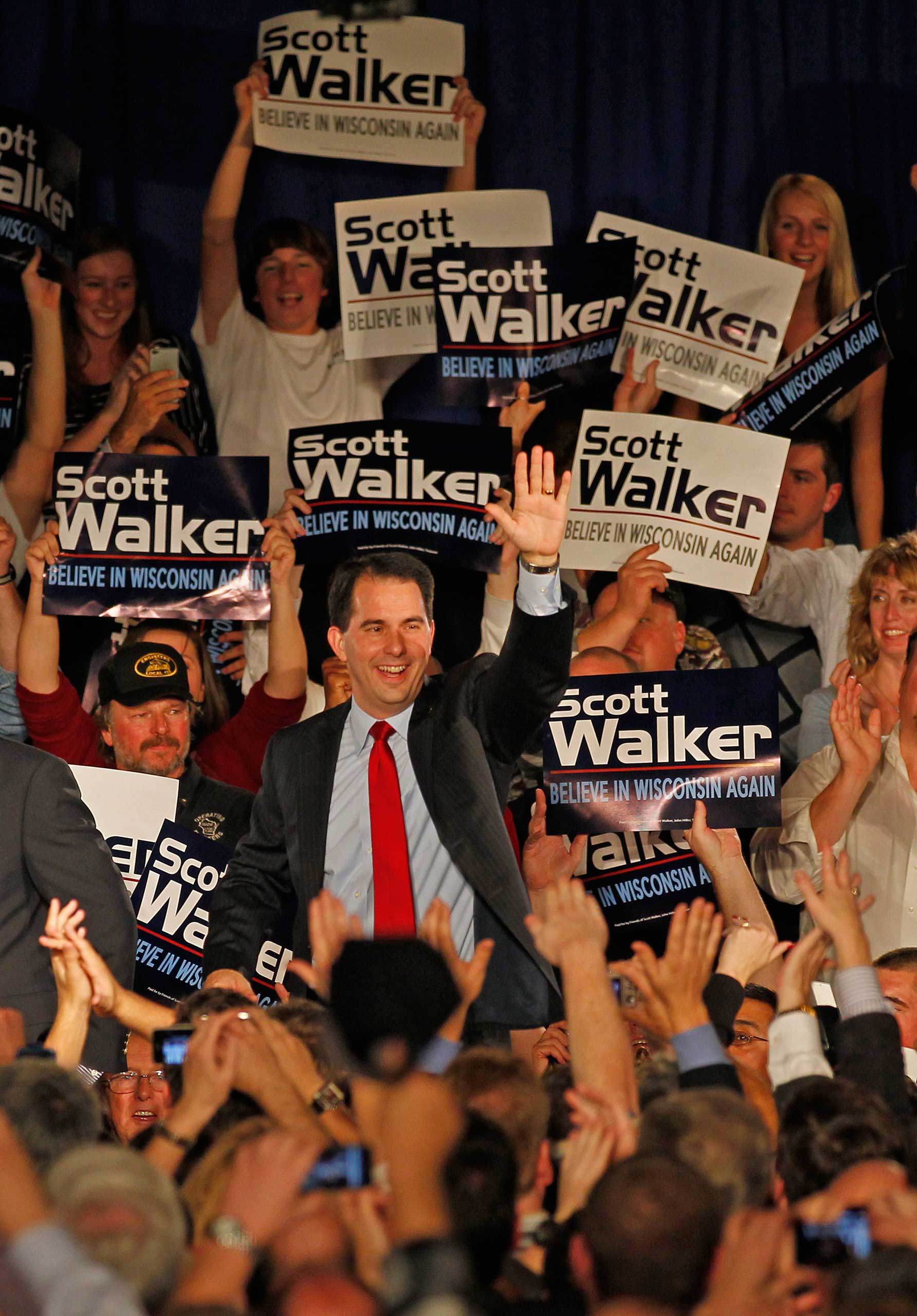 Supporters cheer as Wisconsin Republican gubernatorial candidate Scott Walker enters his victory party, in Pewaukee, Wis. on Nov, 2,  2010.