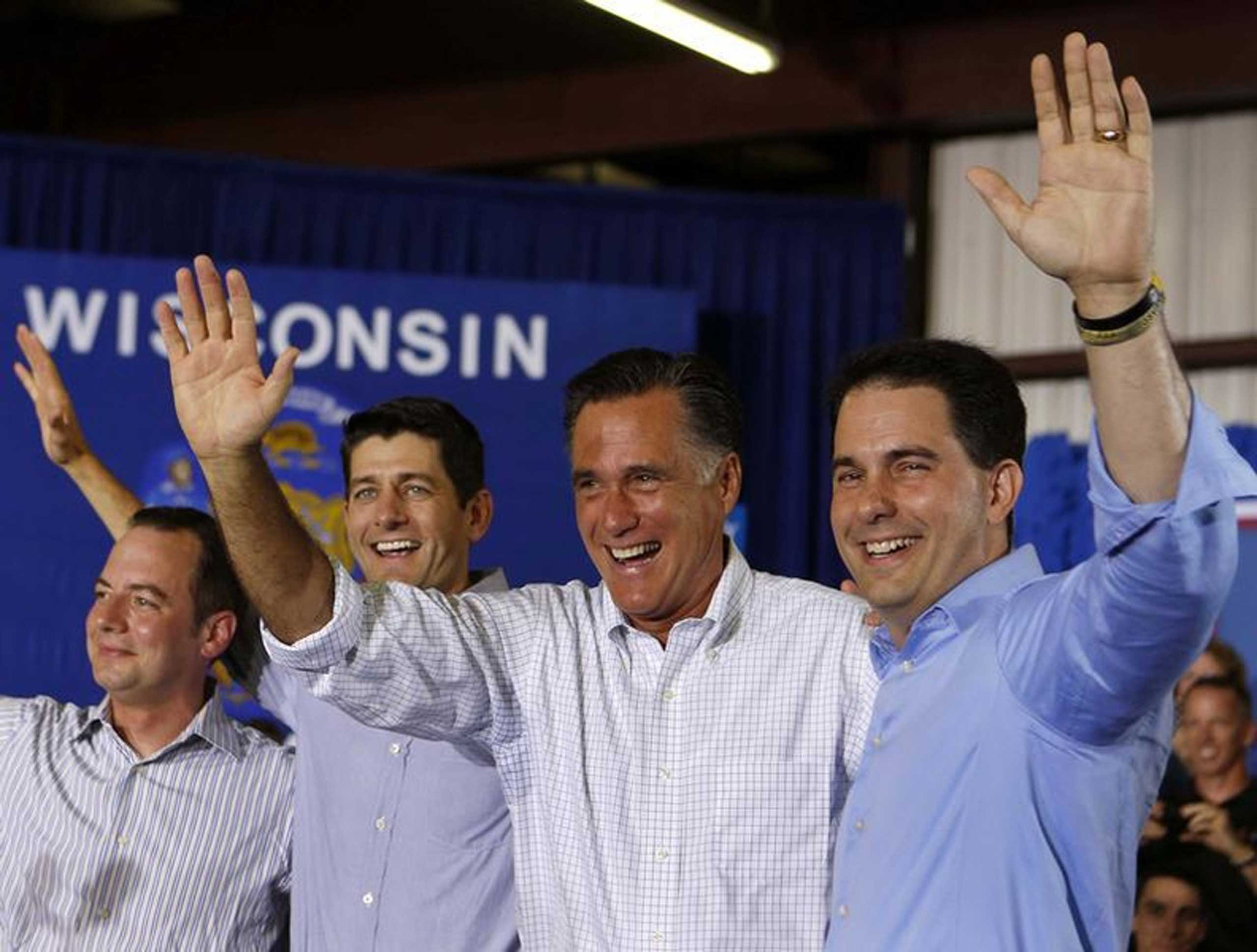 U.S. Republican Presidential candidate Mitt Romney (2nd R) waves next to Governor Scott Walker (R), Representative Paul Ryan (2nd L), and RNC Chairman Reince Priebus (L) before speaking to a crowd at Monterey Mills in Janesville, Wis., June 18, 2012.