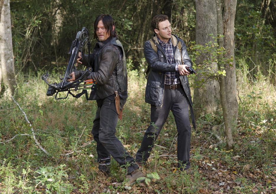 Norman Reedus (L) and Ross Marquand (R) in episode 15 of AMC's 'Walking Dead.'