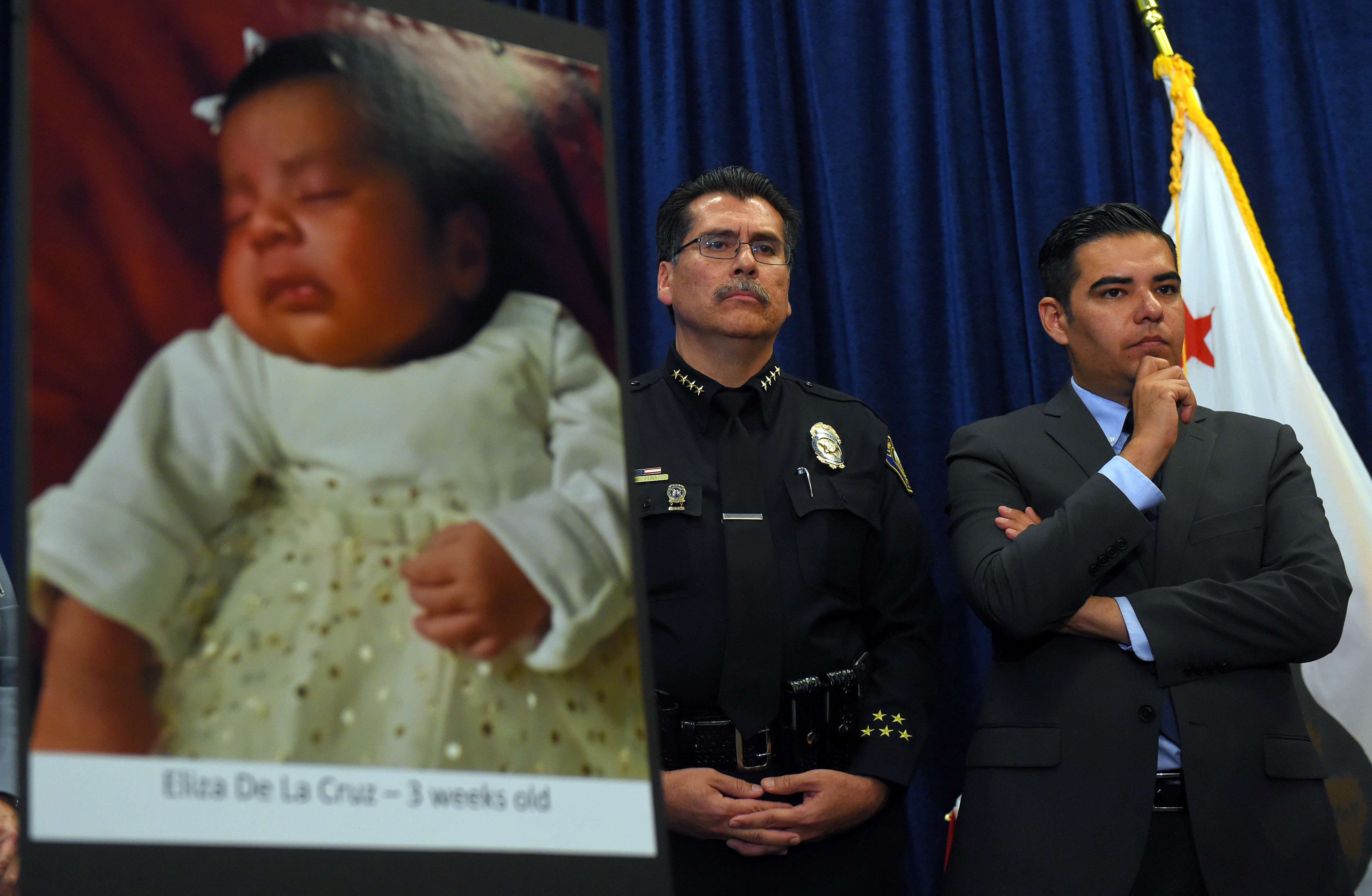 Long Beach police chief Robert Luna, left, and Mayor Robert Garcia stand during a news conference in Long Beach, Calif., on March 25, 2015