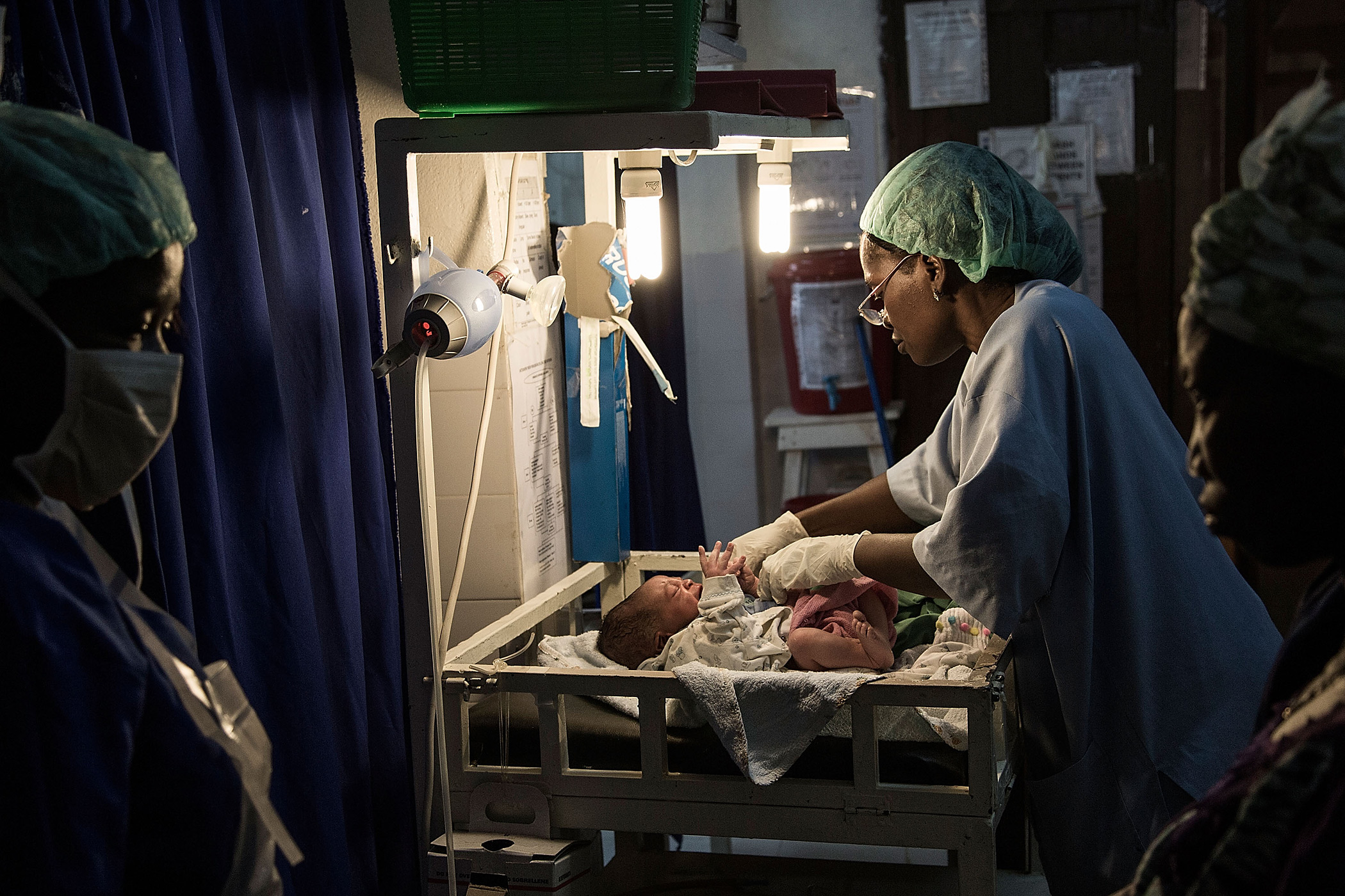 Doctors give emergency treatment to a new born baby at the Gondama Referral Centre on March 9, 2014 in Bo, Sierra Leone.