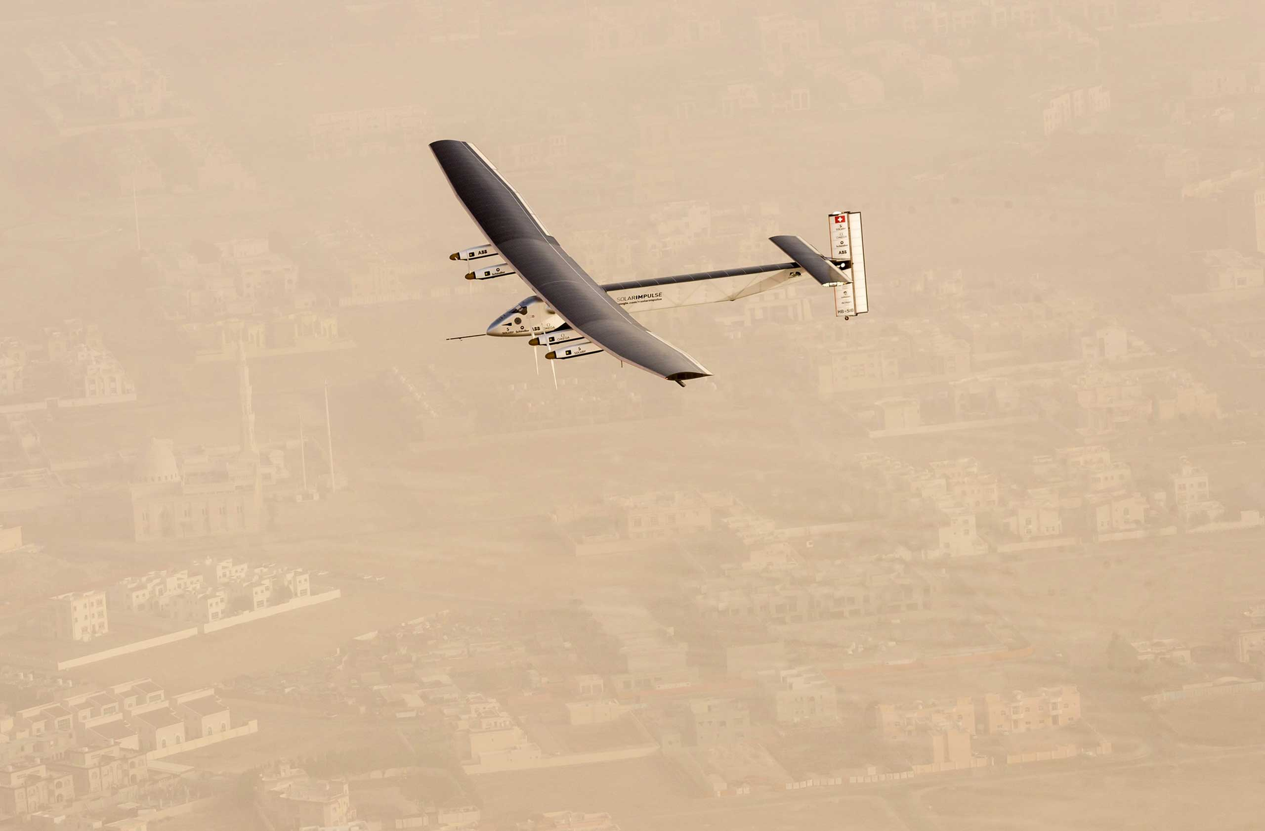 Solar Impulse 2, a solar-powered airplane, takes flight as it begins its historic round-the-world journey from Al Bateen Airport in Abu Dhabi on March 9, 2015.