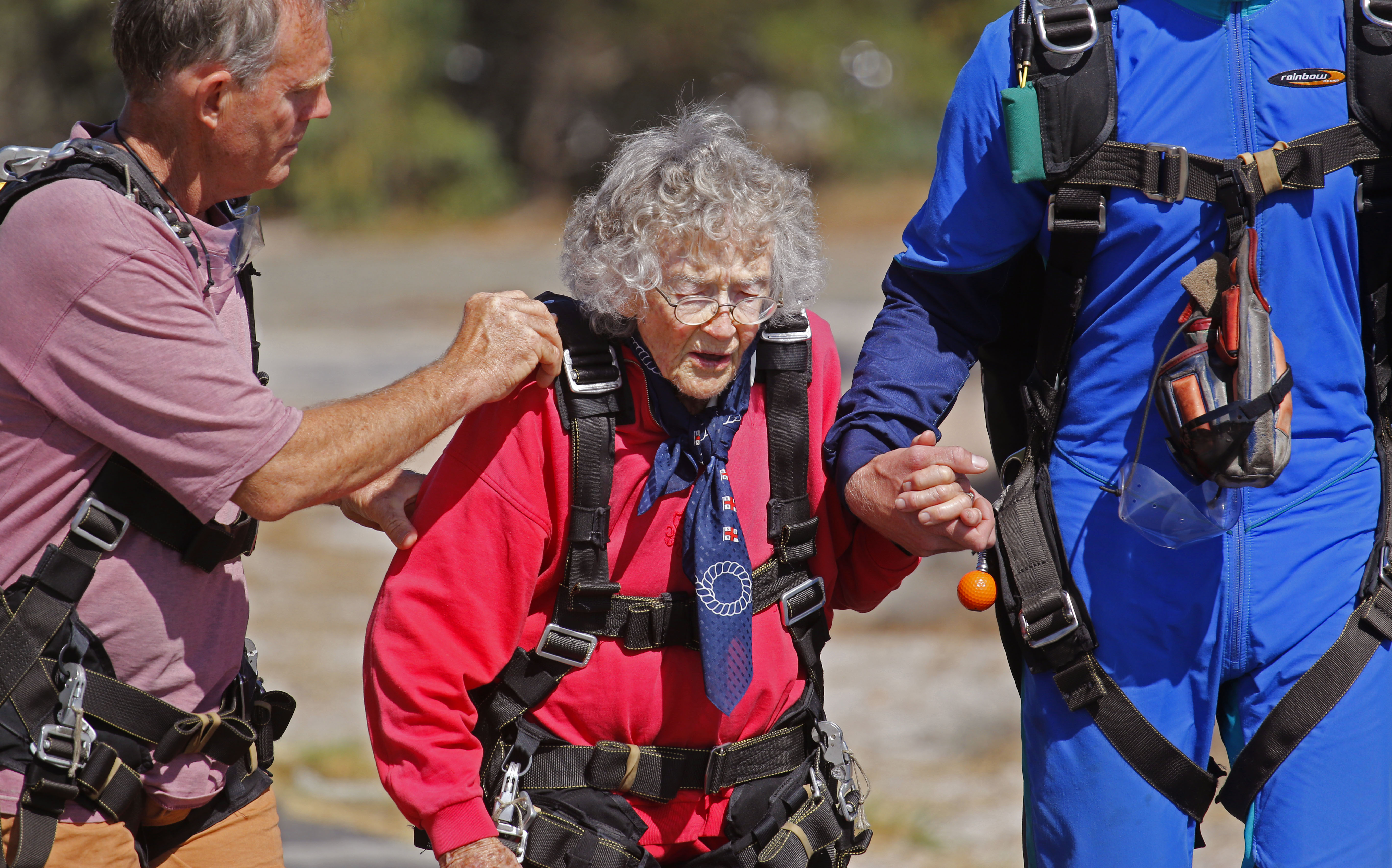 Hundred year old Georgina Harwood walks to the aeroplane before her tandem parachute jump forming part of her birthday celebration in Cape Town, South Africa. Celebrating her 100th birthday with a parachute jump is not enough for South African Georgina Harwood. She plans to make her centenary even more exciting by doing a shark cage dive on Monday. (AP Photo/Schalk van Zuydam)