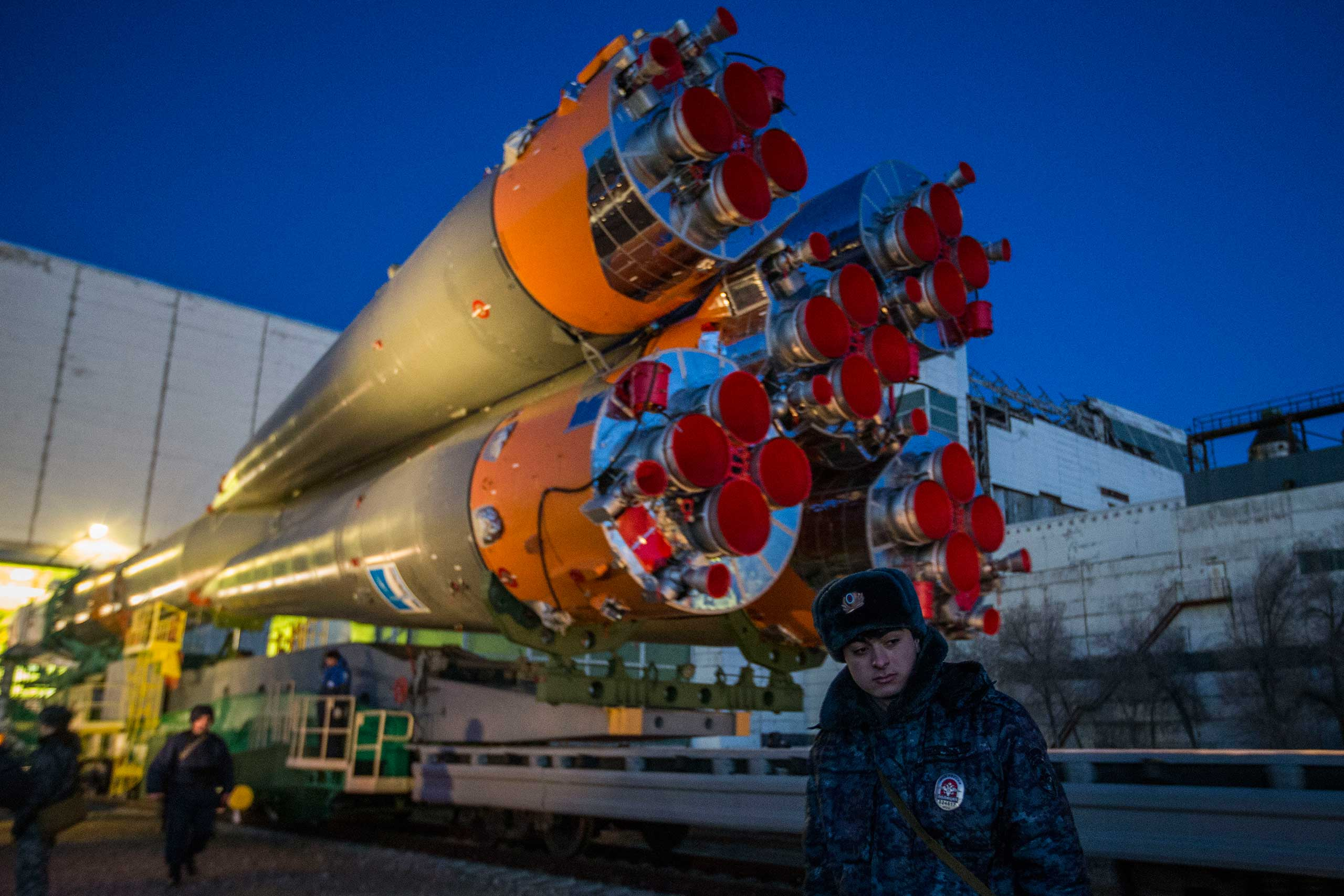 A member of the Russian guard stands in front of the Soyuz as it is rolled out for launch at the Baikonur Cosmodrome in Kazakhstan on Wednesday, March 25.