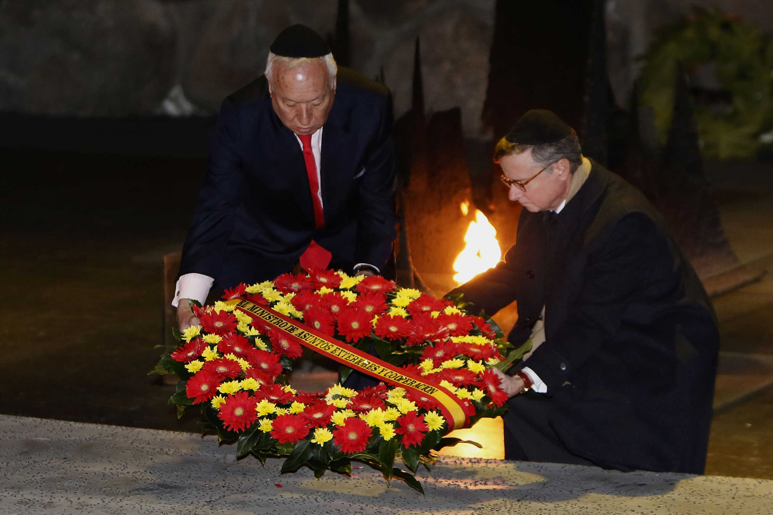 Spanish Foreign Minister Jose Manuel Garcia-Margallo (L) lays a wreath at the Hall of Remembrance on Jan. 14, 2015, during his visit to the Yad Vashem Holocaust Memorial museum in Jerusalem that commemorates the six million Jews killed by the Nazis during World War II.