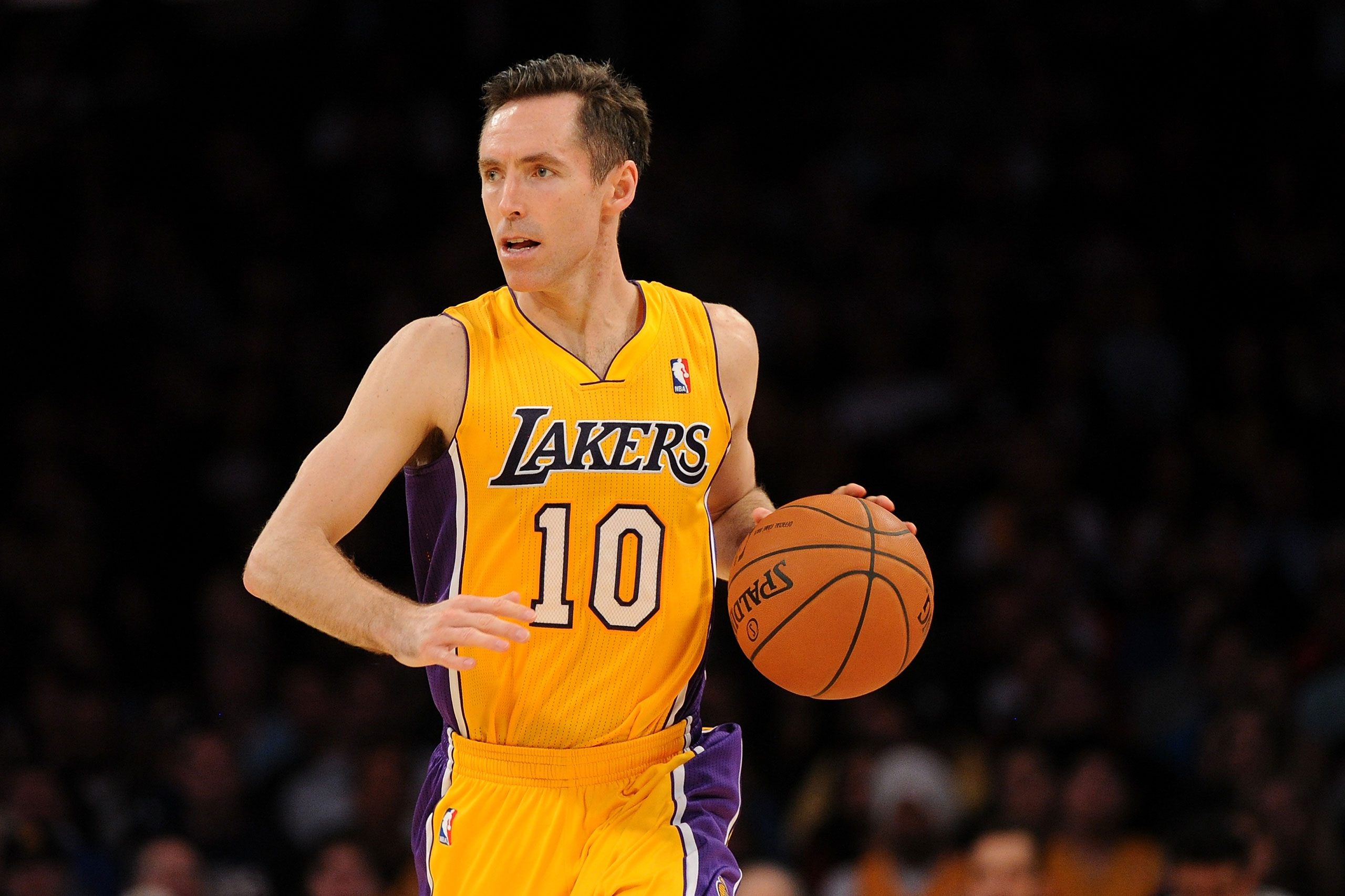 Steve Nash of the Los Angeles Lakers drives the ball upcourt during a game against the Utah Jazz at Staples Center on Feb. 11, 2014 in Los Angeles.