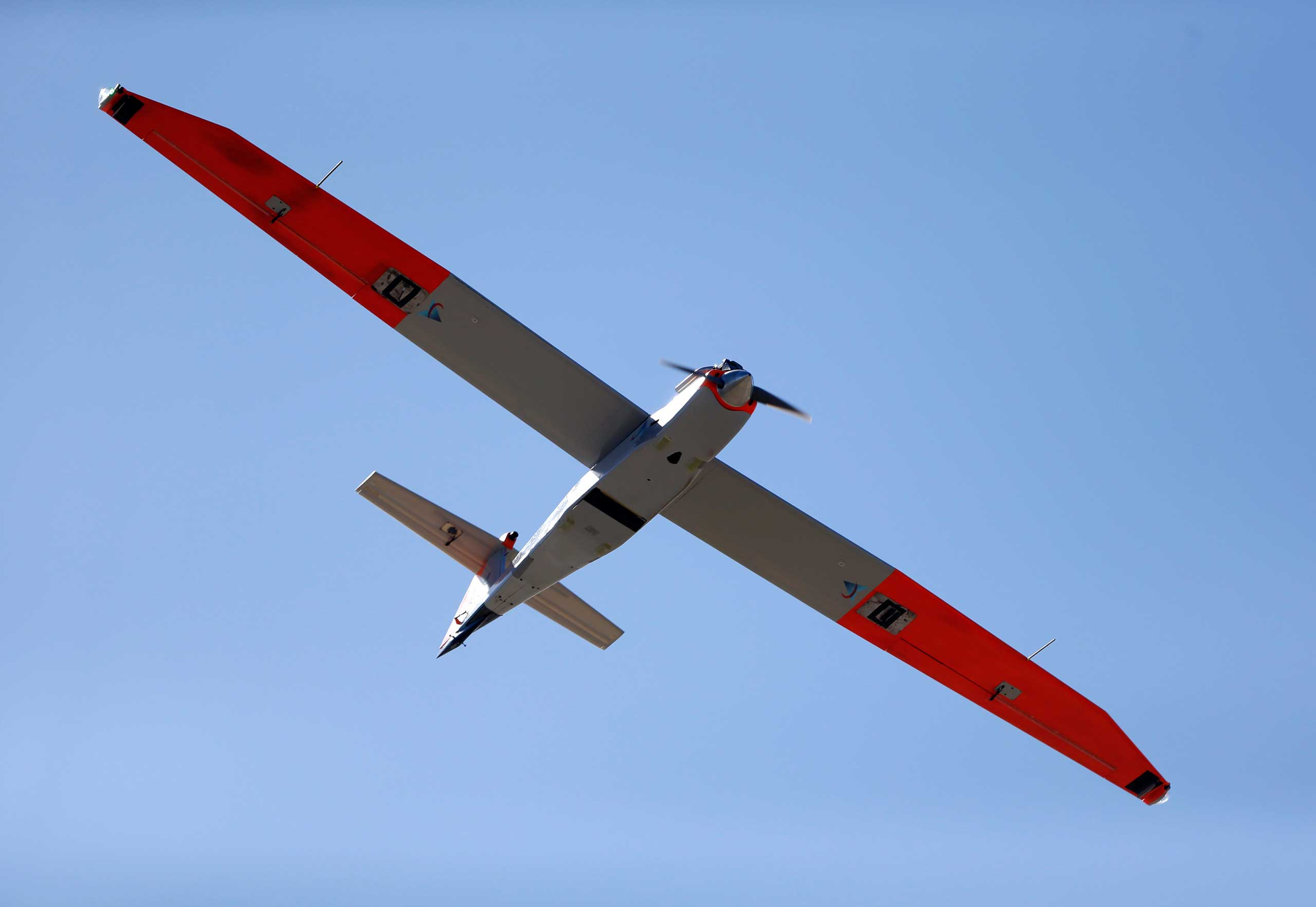 A test drone with a wing span of almost 13 feet flies over a ranch near Sarita, Texas, Jan. 15, 2014.