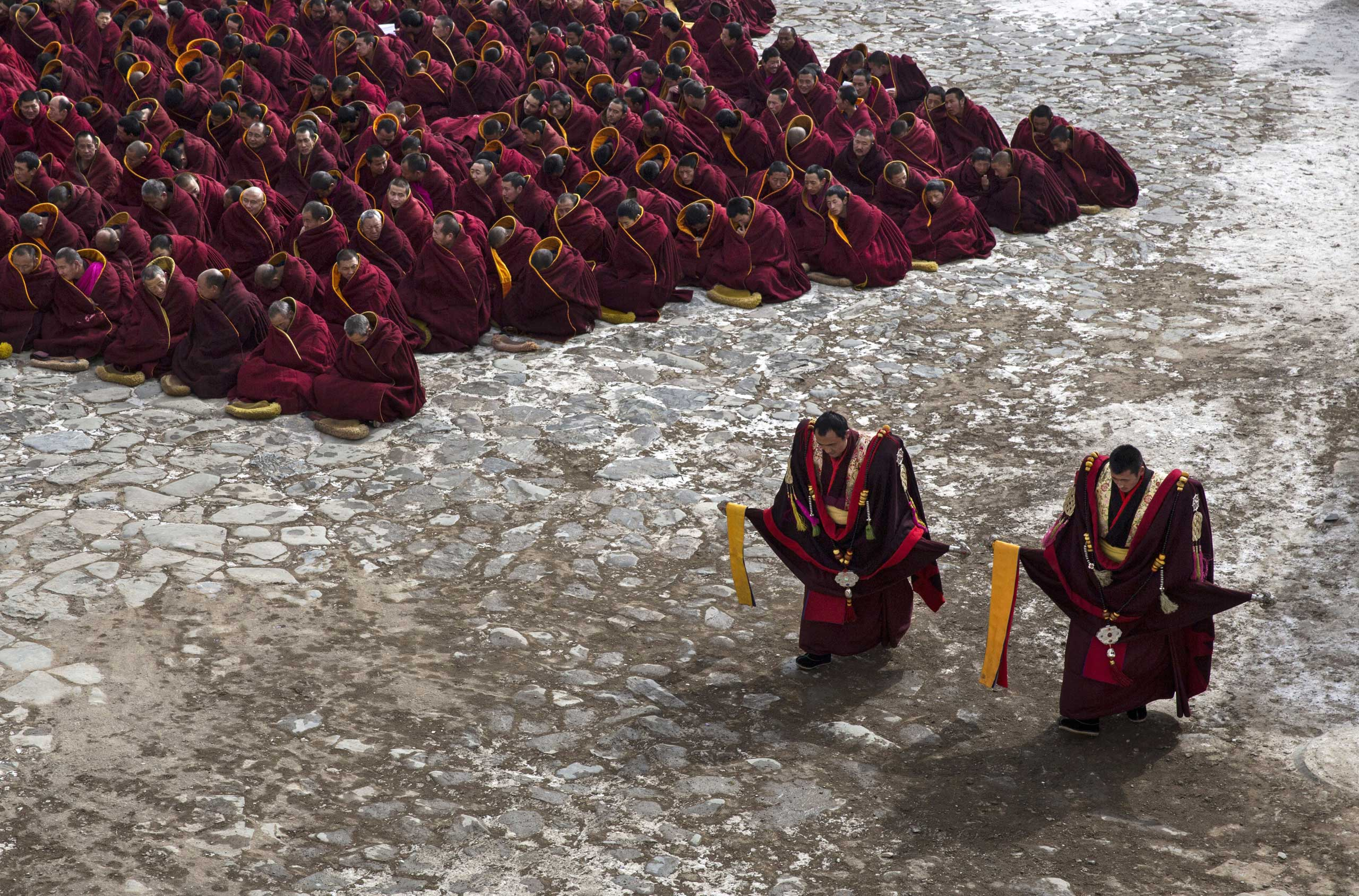 Tibetan Buddhist monks take part in a special prayer during Monlam or the Great Prayer rituals on March 5, 2015 at the Labrang Monastery.