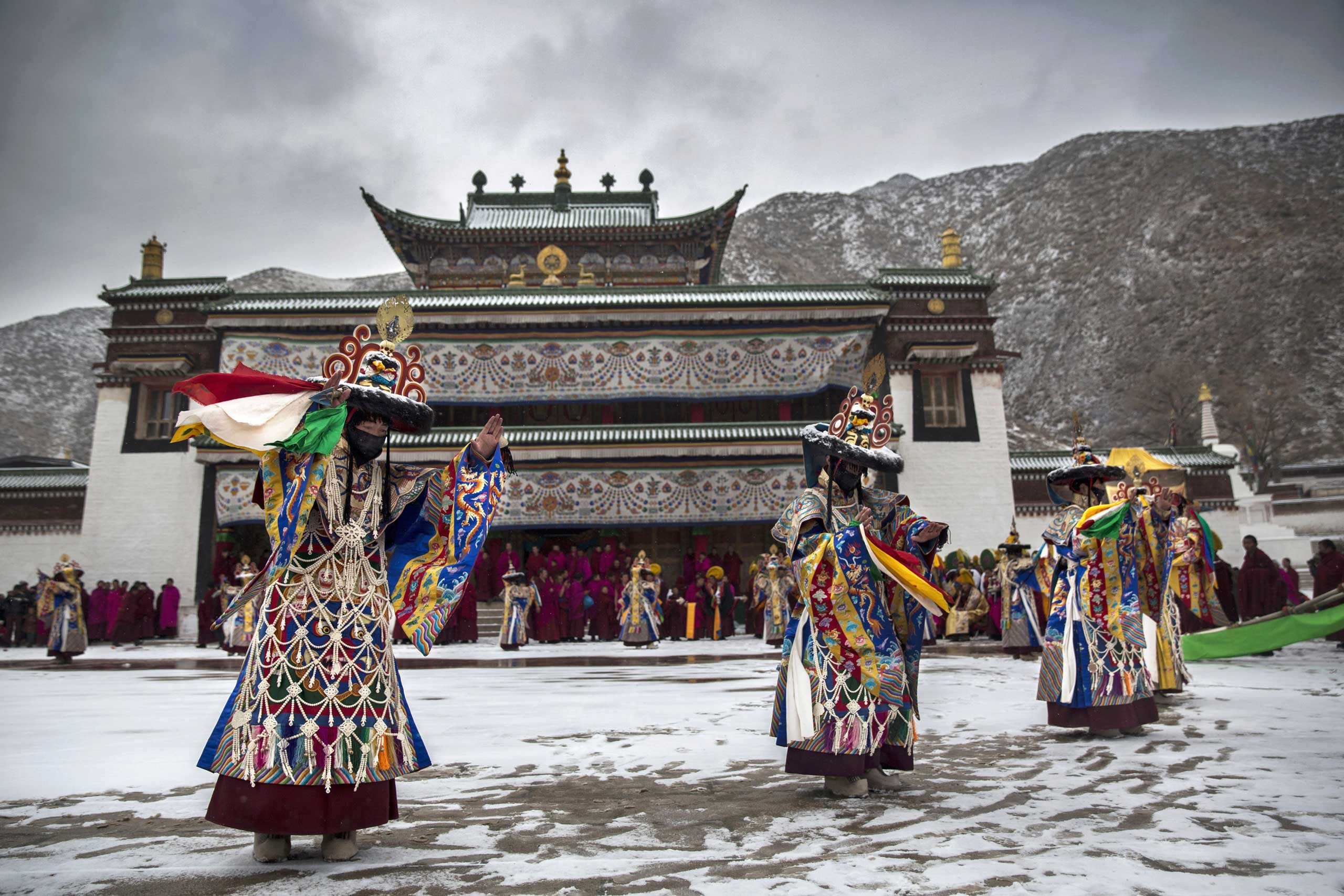 Tibetan Buddhist monks perform a black hat dance during Monlam or the Great Prayer rituals on March 4, 2015 at the Labrang Monastery.