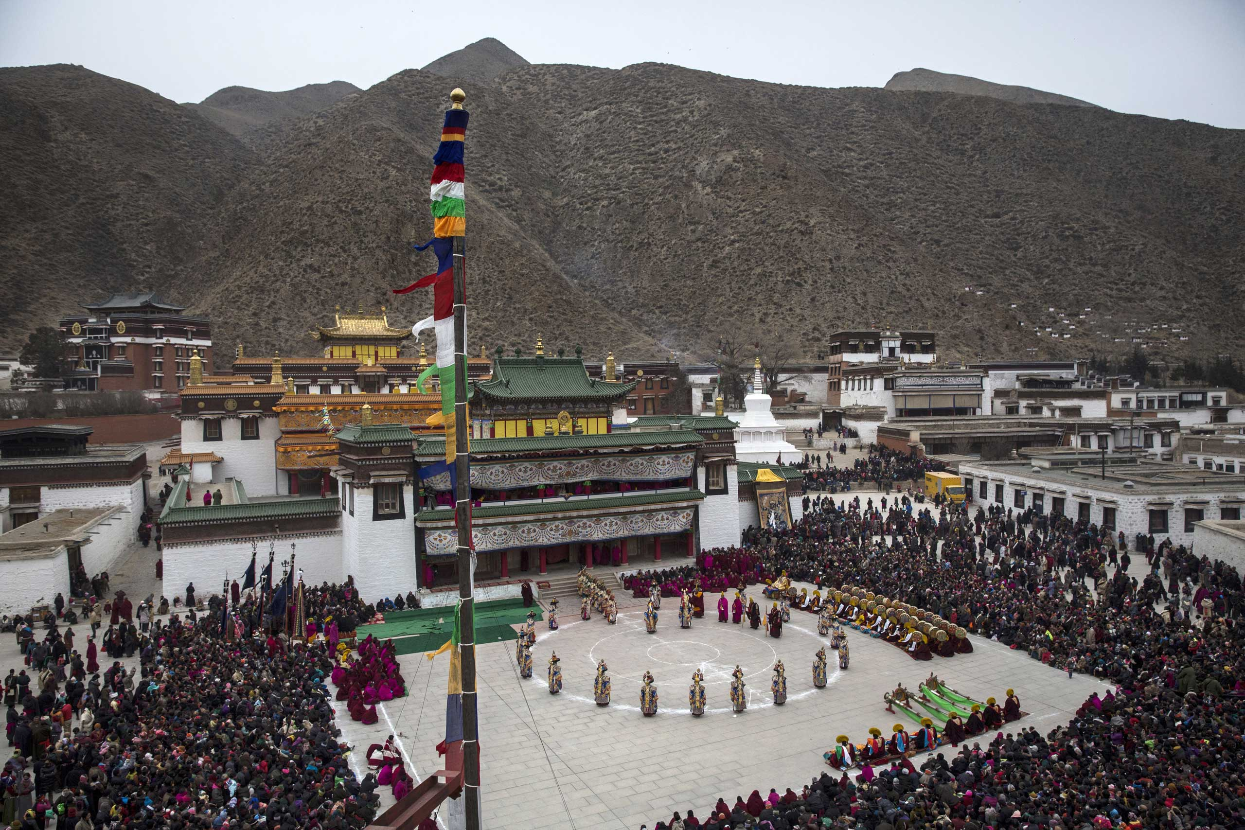 Tibetan Buddhist monks perform a mask dance during Monlam or the Great Prayer rituals on March 4, 2015 at the Labrang Monastery.