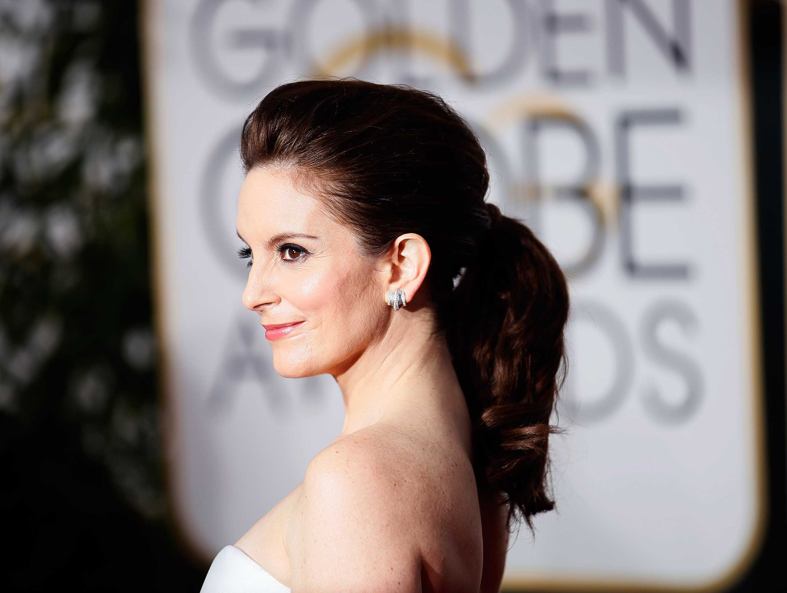 Tina Fey arrives at the 72nd Golden Globe Awards in Beverly Hills, California, Jan. 11, 2015.