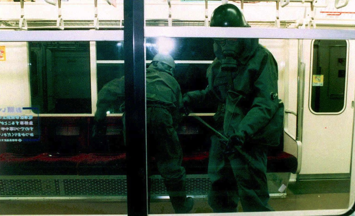 Wearing gas masks, members of the Japanese Ground Self-Defense Forces (JSDF) clean up subway cars late on March 20, 1995