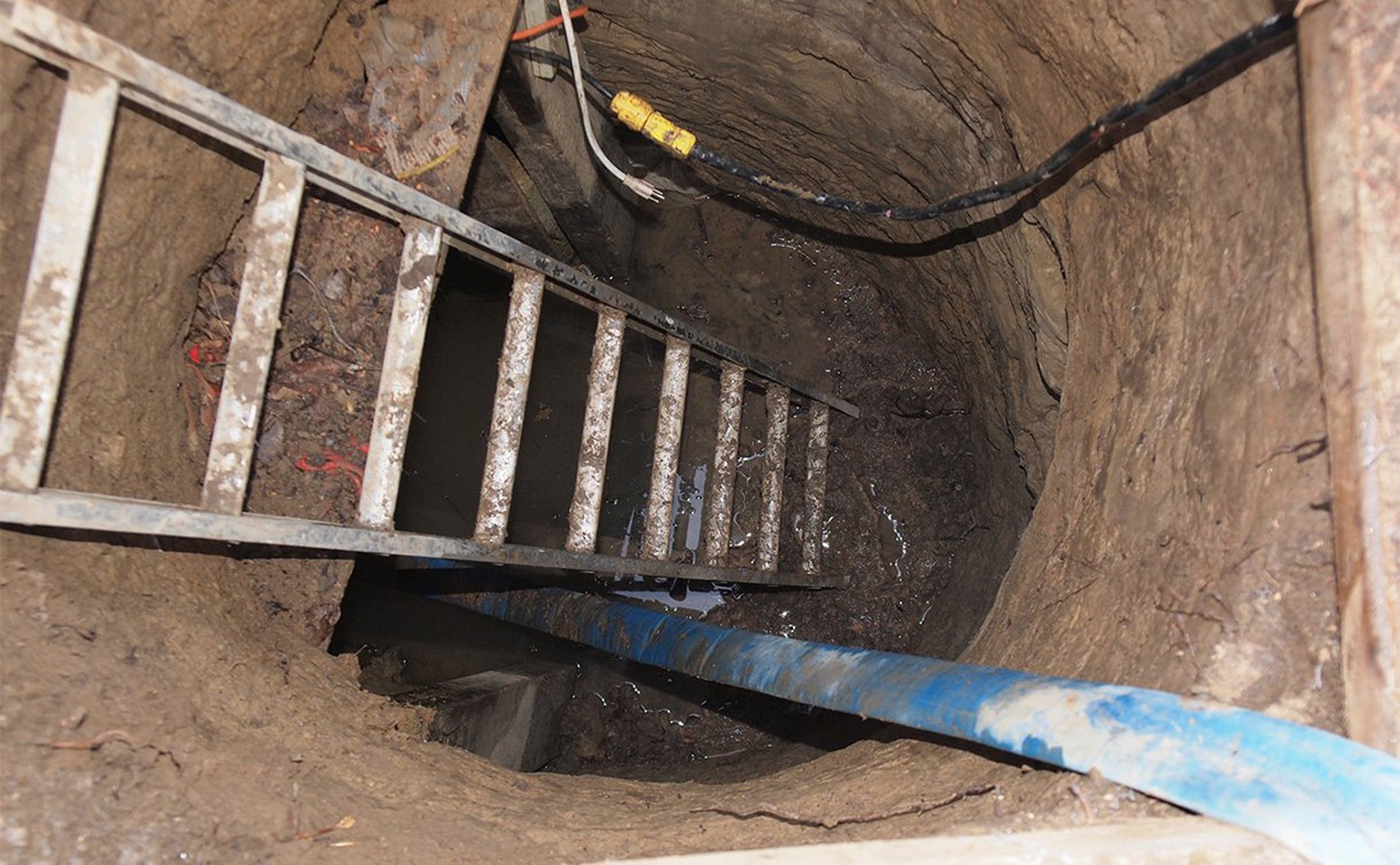 A ladder leading to a 33-foot-long tunnel supported using lumber found in Toronto on Feb. 24, 2015.