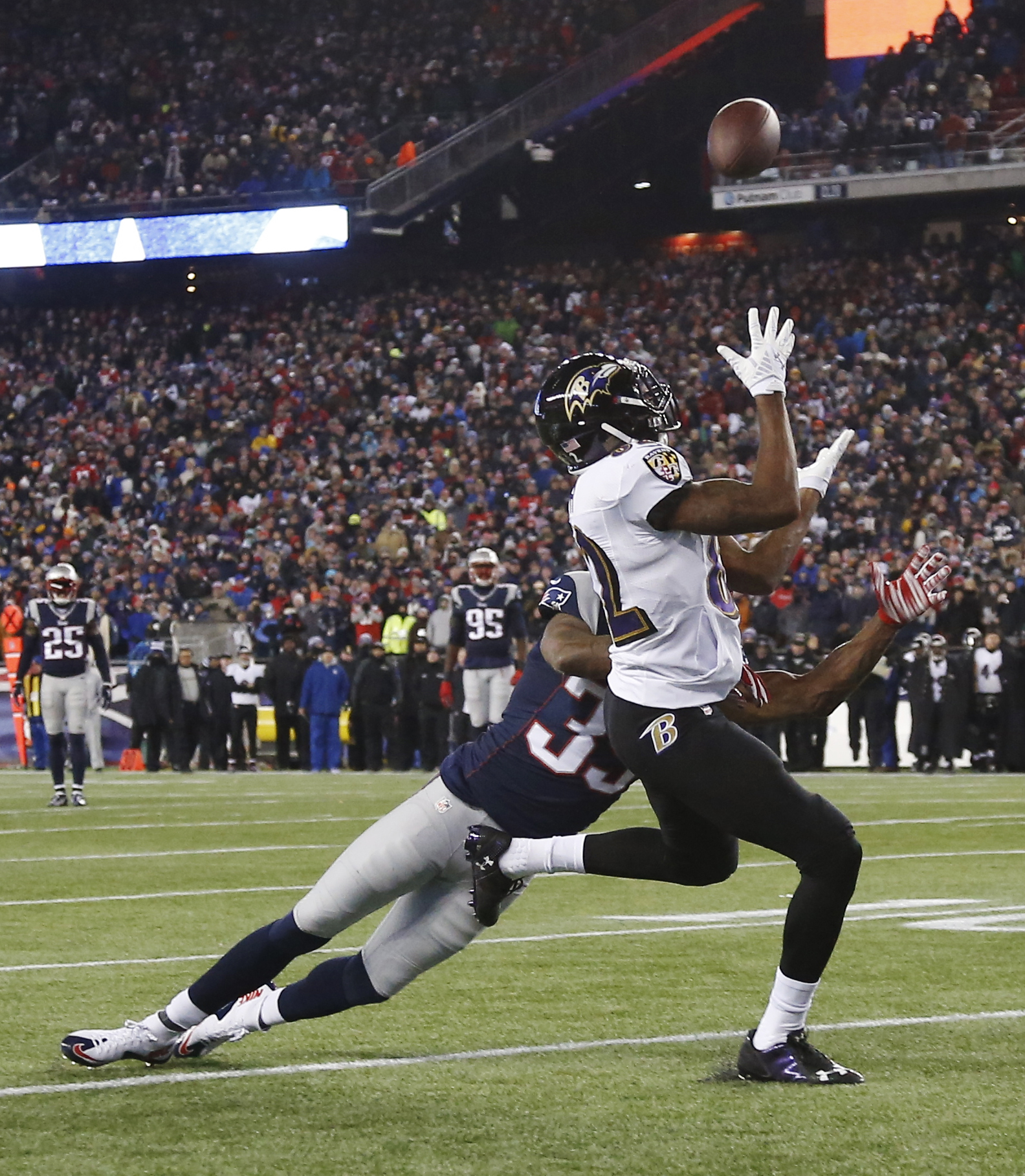 Baltimore Ravens wide receiver Torrey Smith (82) catches a pass in front of New England Patriots cornerback Brandon Browner (39) in the second half of an NFL divisional playoff football game Saturday, Jan. 10, 2015, in Foxborough, Mass.