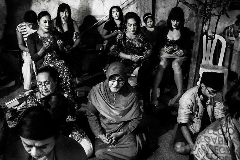 Shinta Ratri prays during the annual LGBT and waria community meeting in Yogyakarta, Java Island, Indonesia, August 2014.