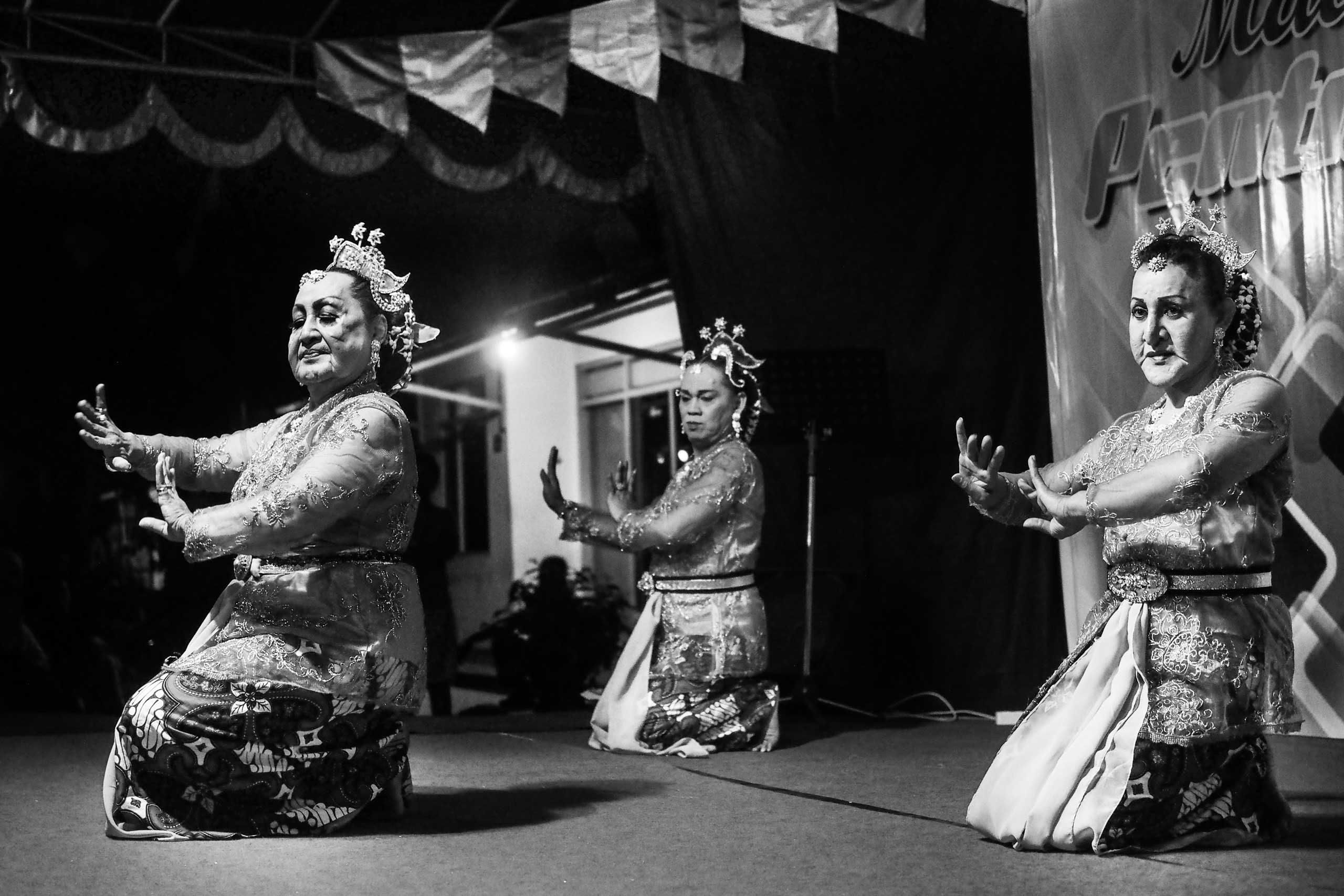 Shinta Ratri performs a Balinese dance wearing a typical dress with two other transgender friends at a local street festival in Yogyakarta.