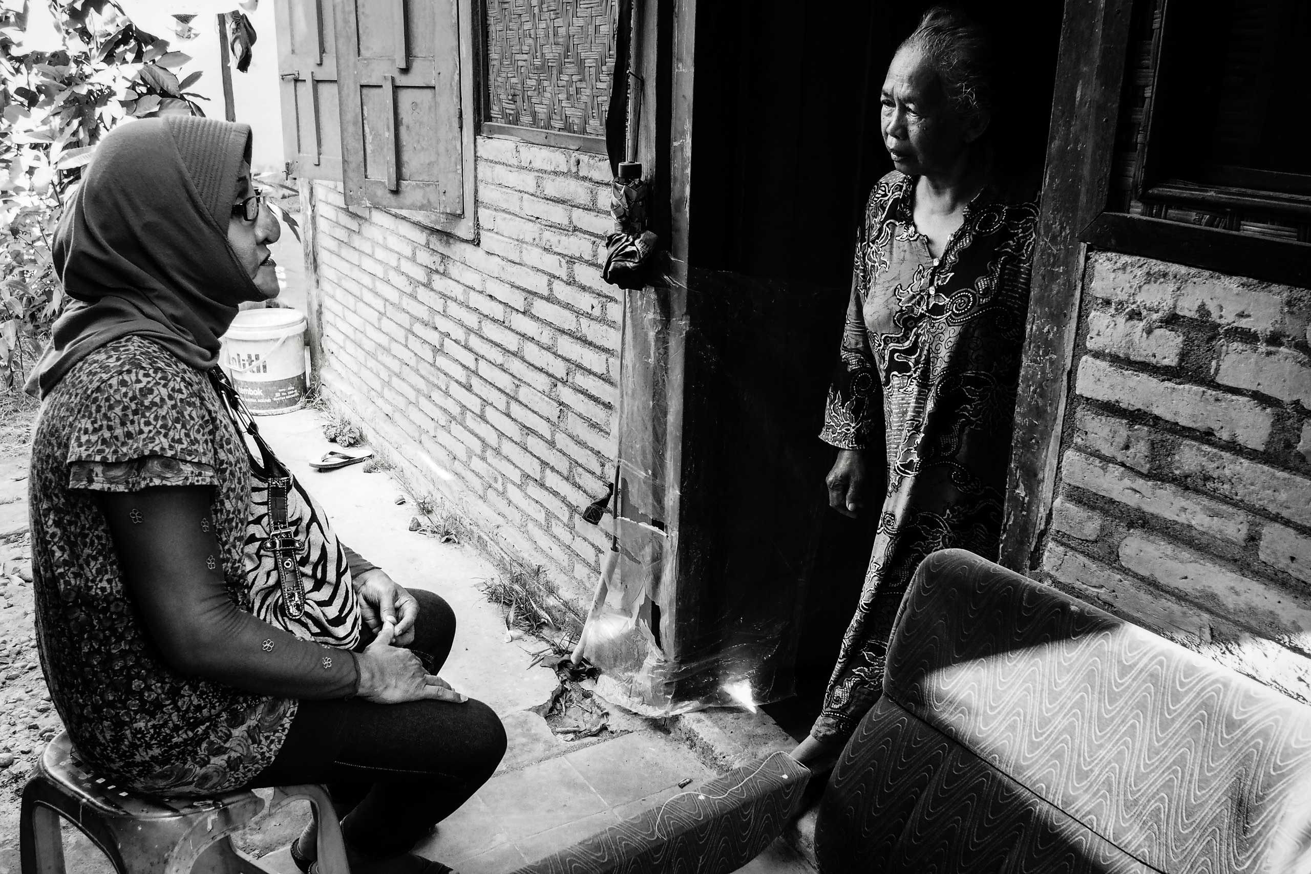 Shinta Ratri talks to her mother on the threshold of her family house where she is not allowed to enter.